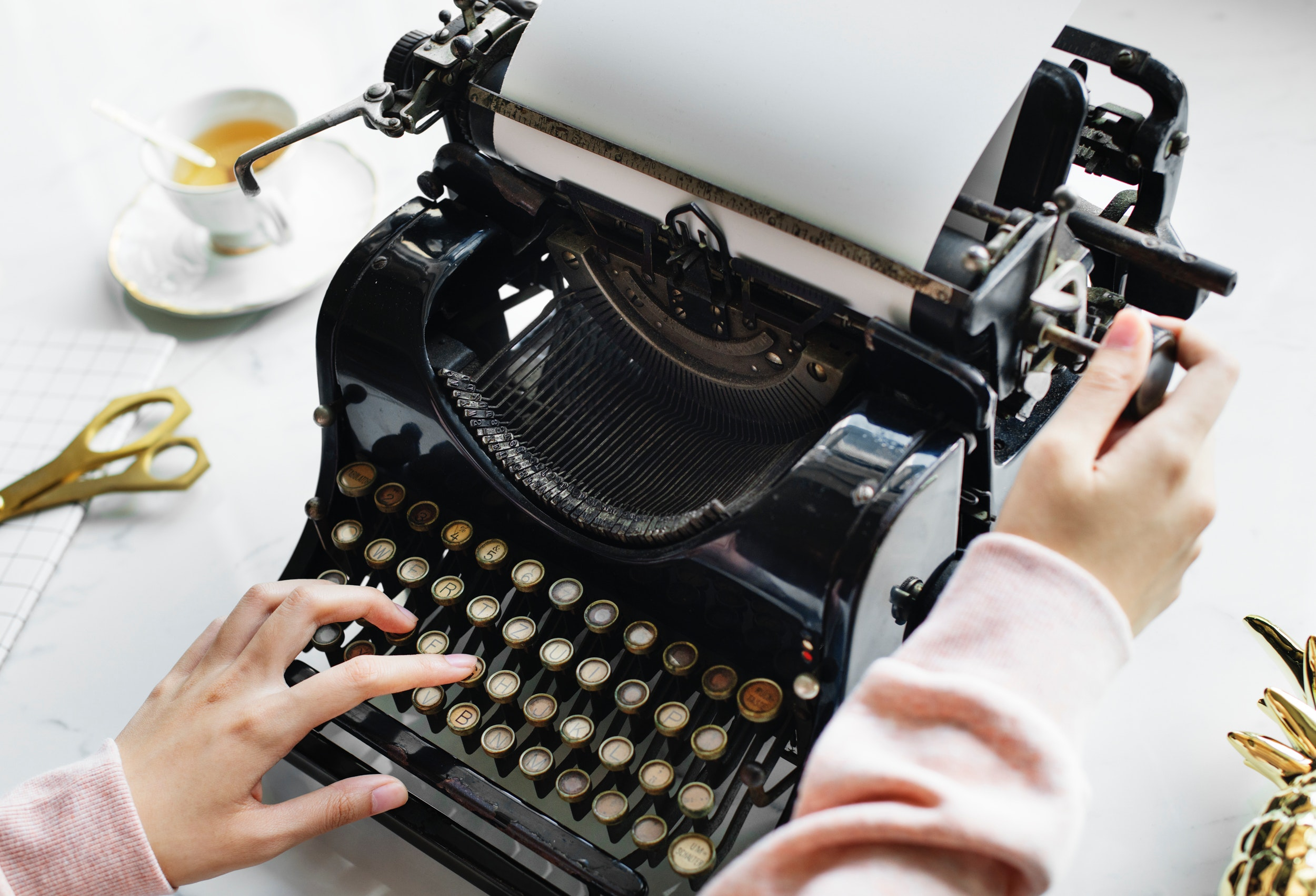Woman uses black typewriter photo