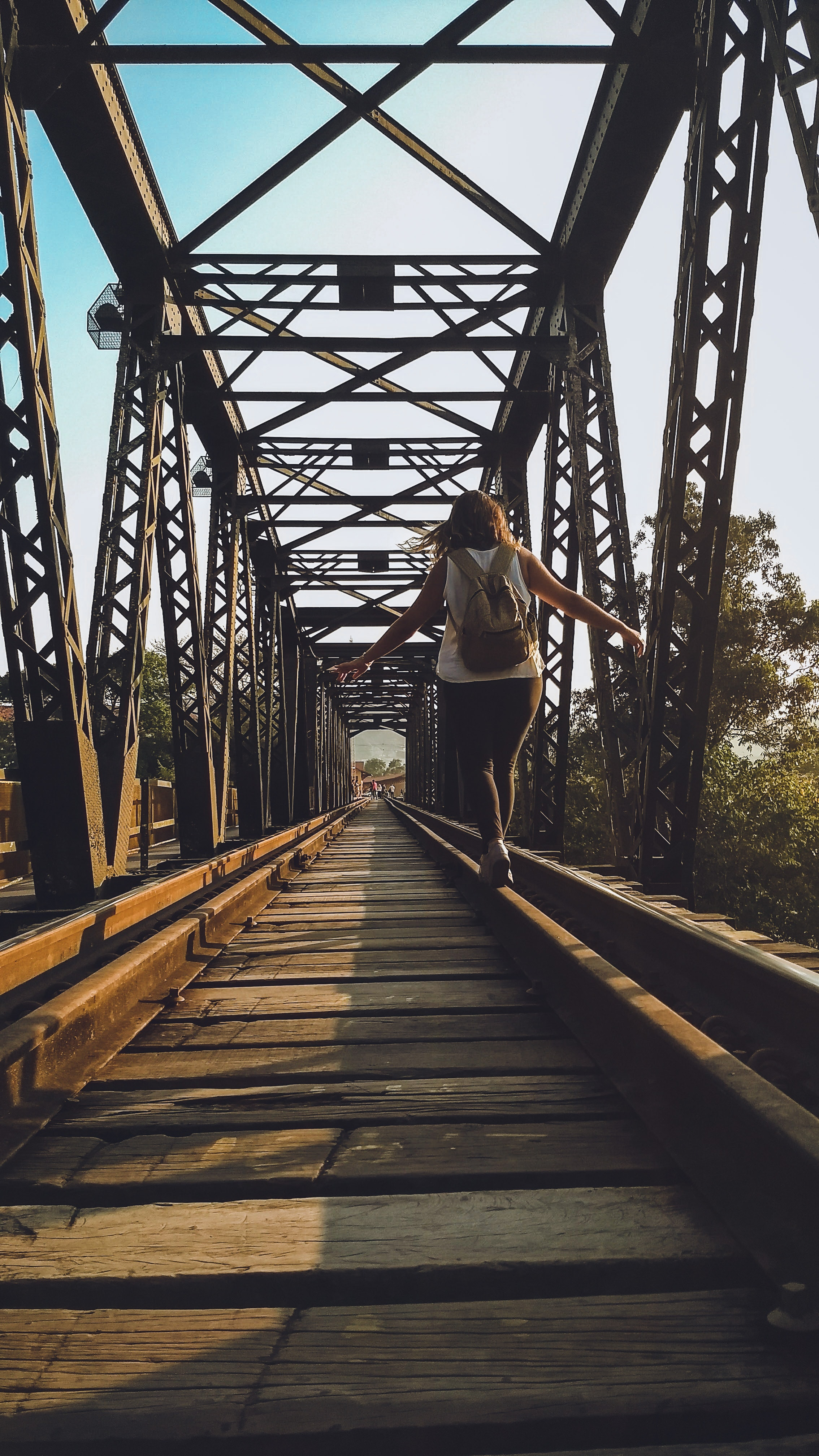 Woman walking on a train rail photo