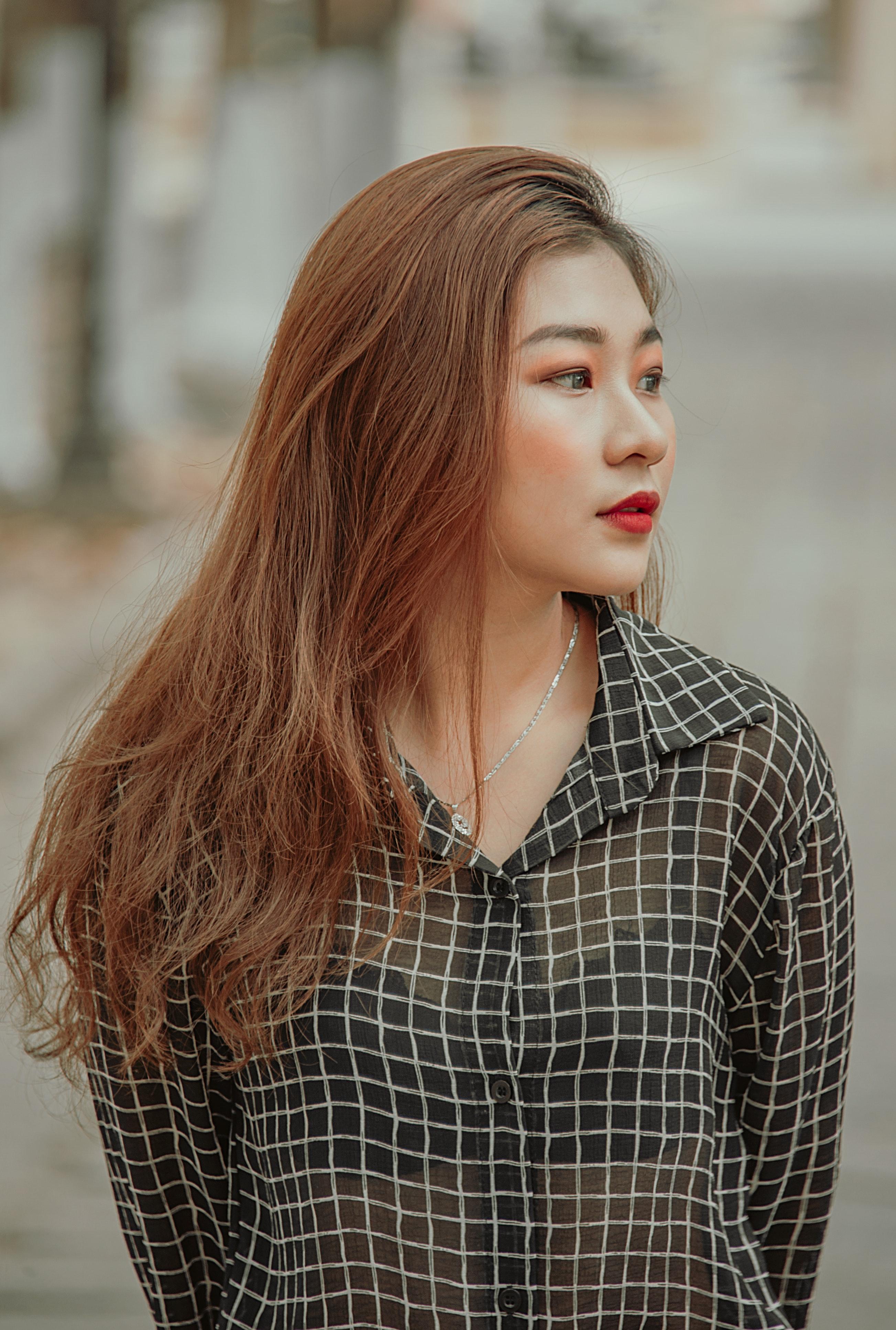Woman wearing black and white checkered dress shirt photo