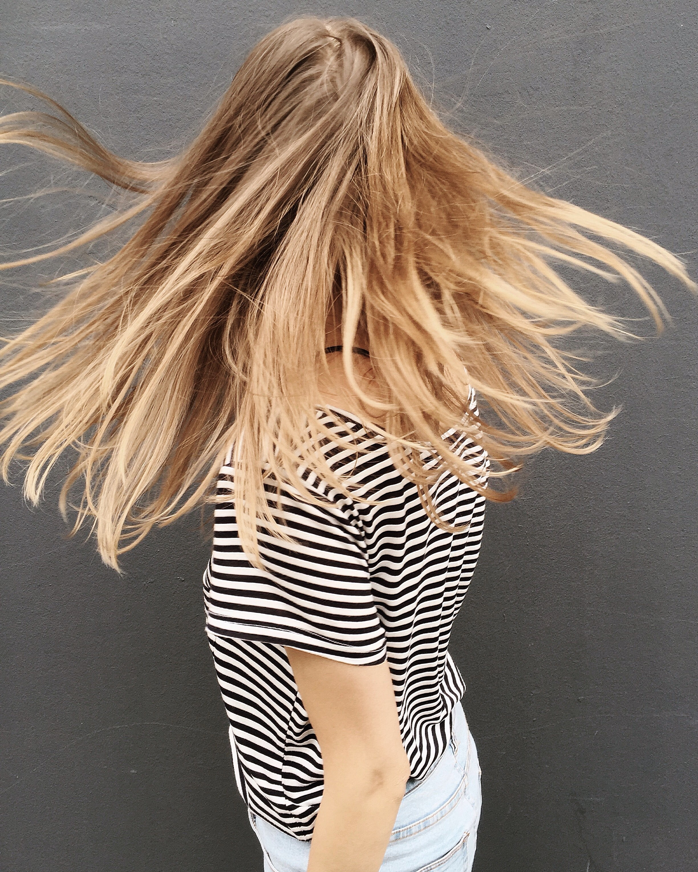 Woman wearing black and white stripe blouse photo