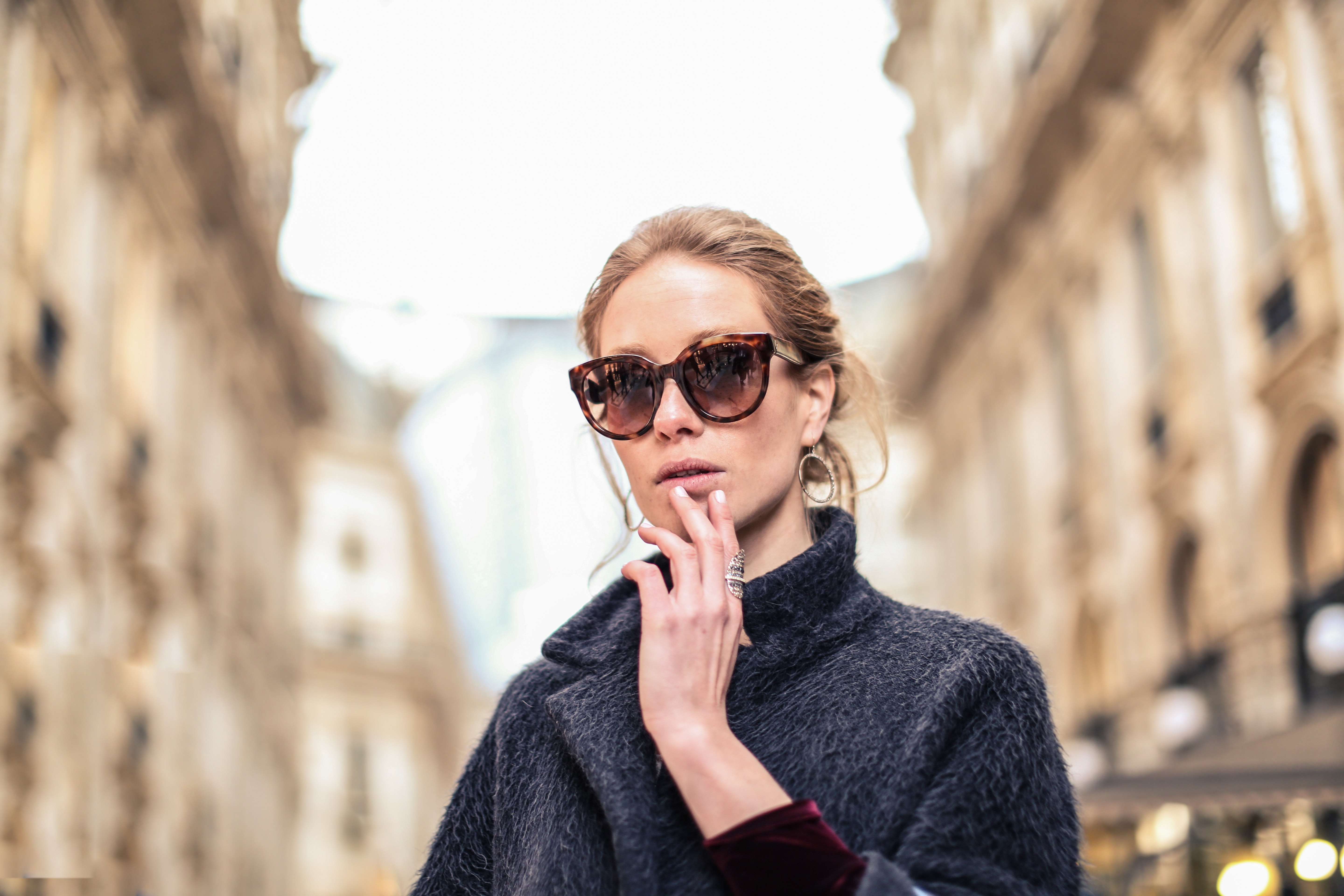 Woman wearing black coat and brown framed sunglasses photo
