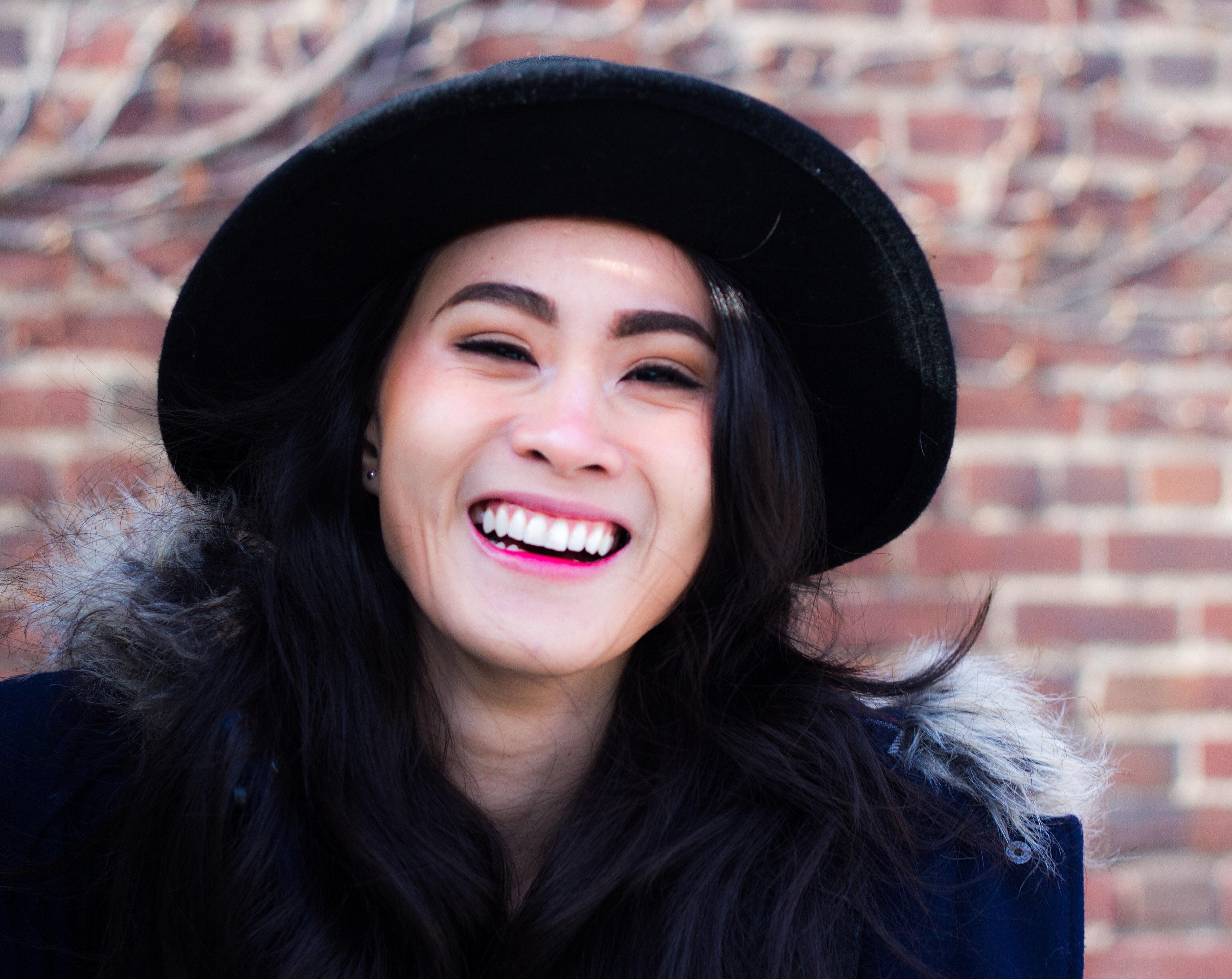 Woman wearing black fedora hat photo