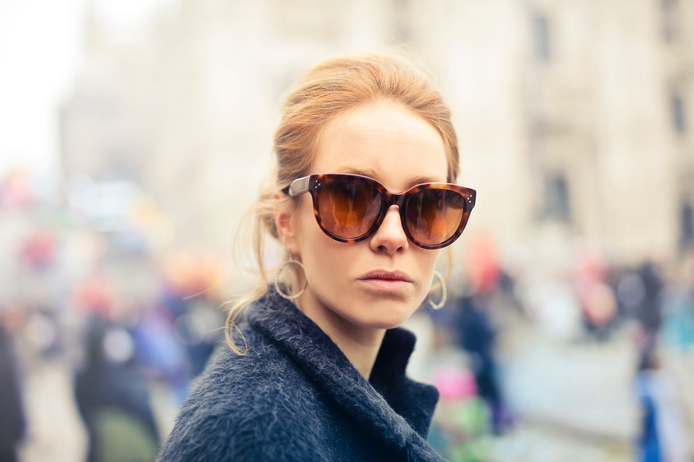 Woman wearing black-framed sunglasses photo