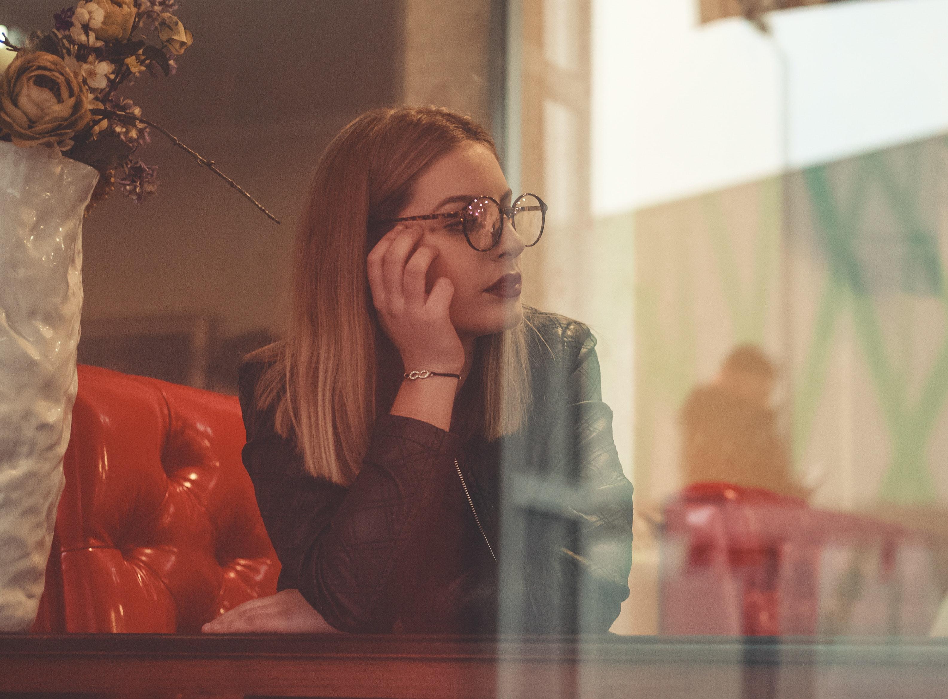 Woman wearing black jacket and black framed eyeglasses photo