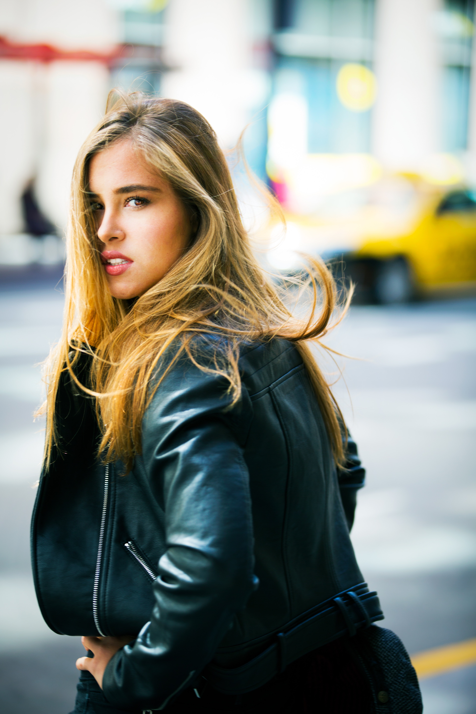 Woman wearing black leather jacket facing backward photo
