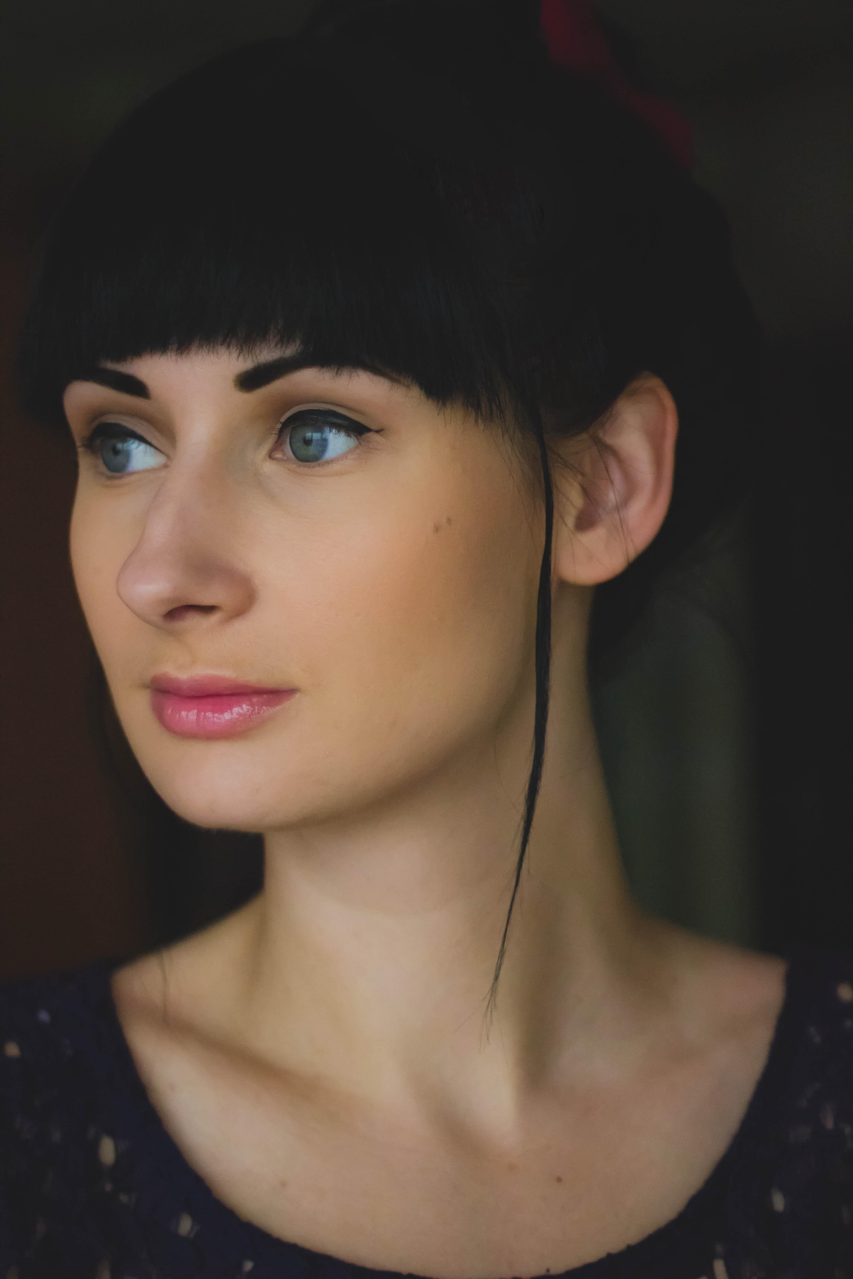 Woman wearing black scoop neck shirt photo