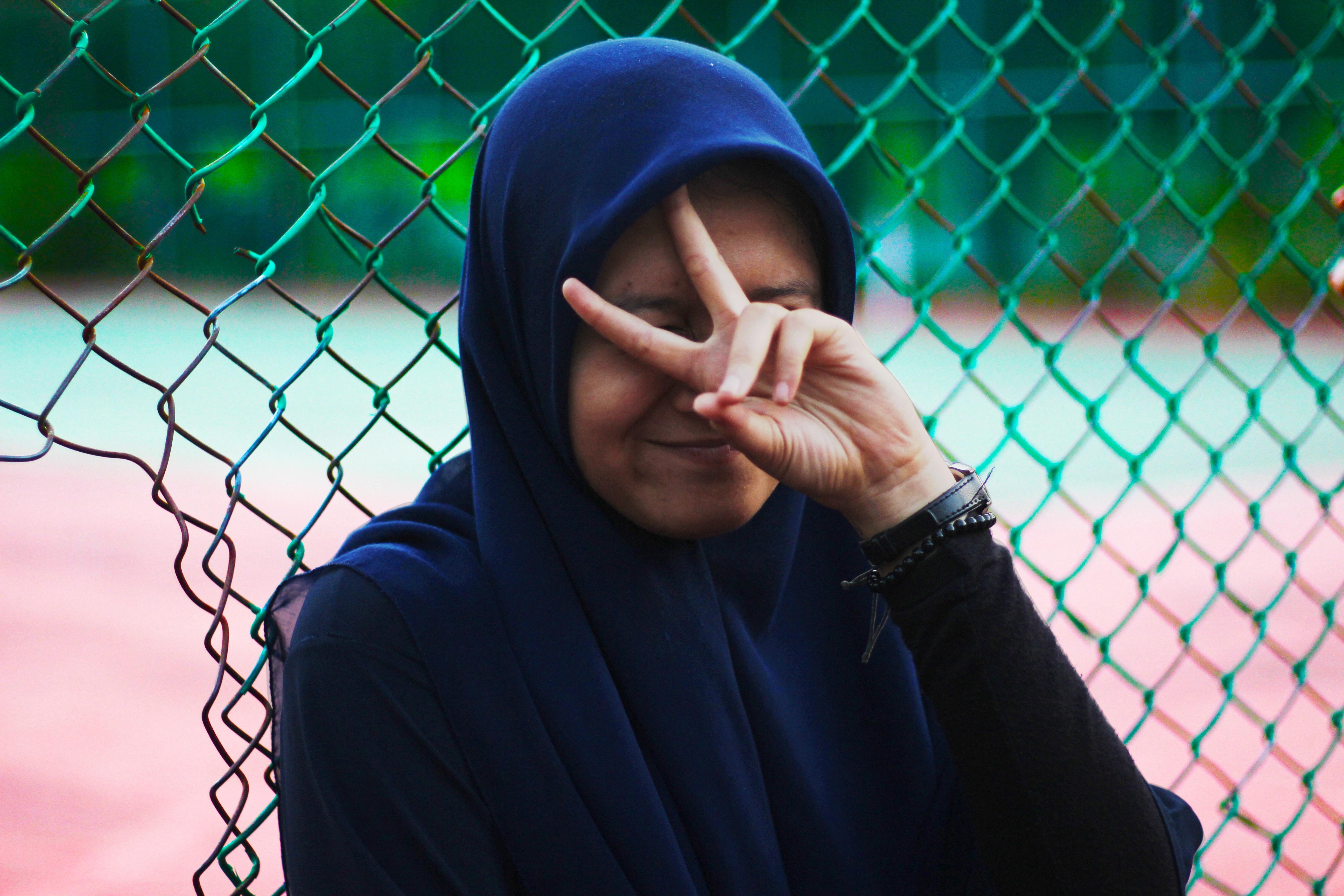 Woman wearing blue hijab photo