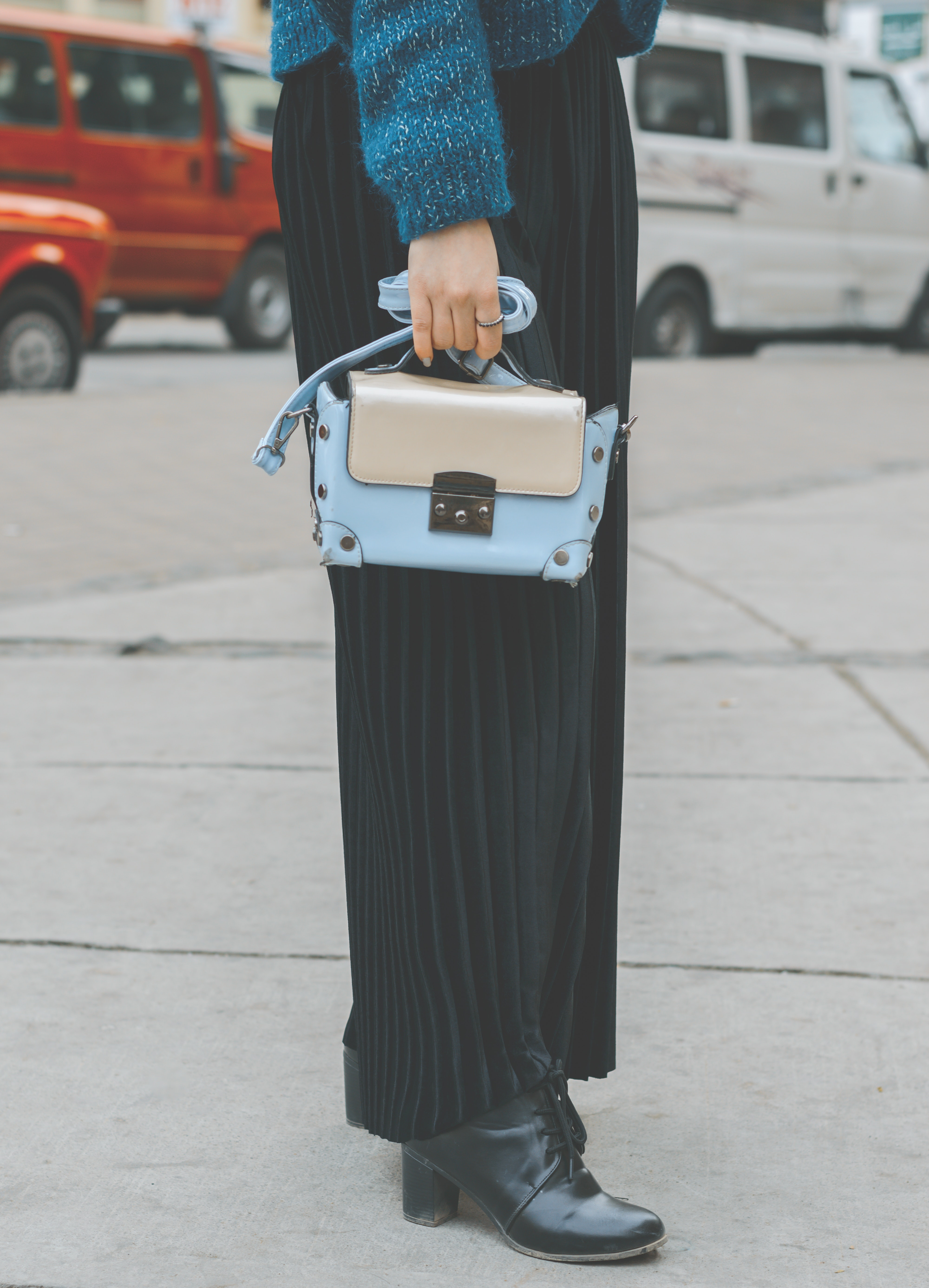 Woman wearing blue leather purse photo