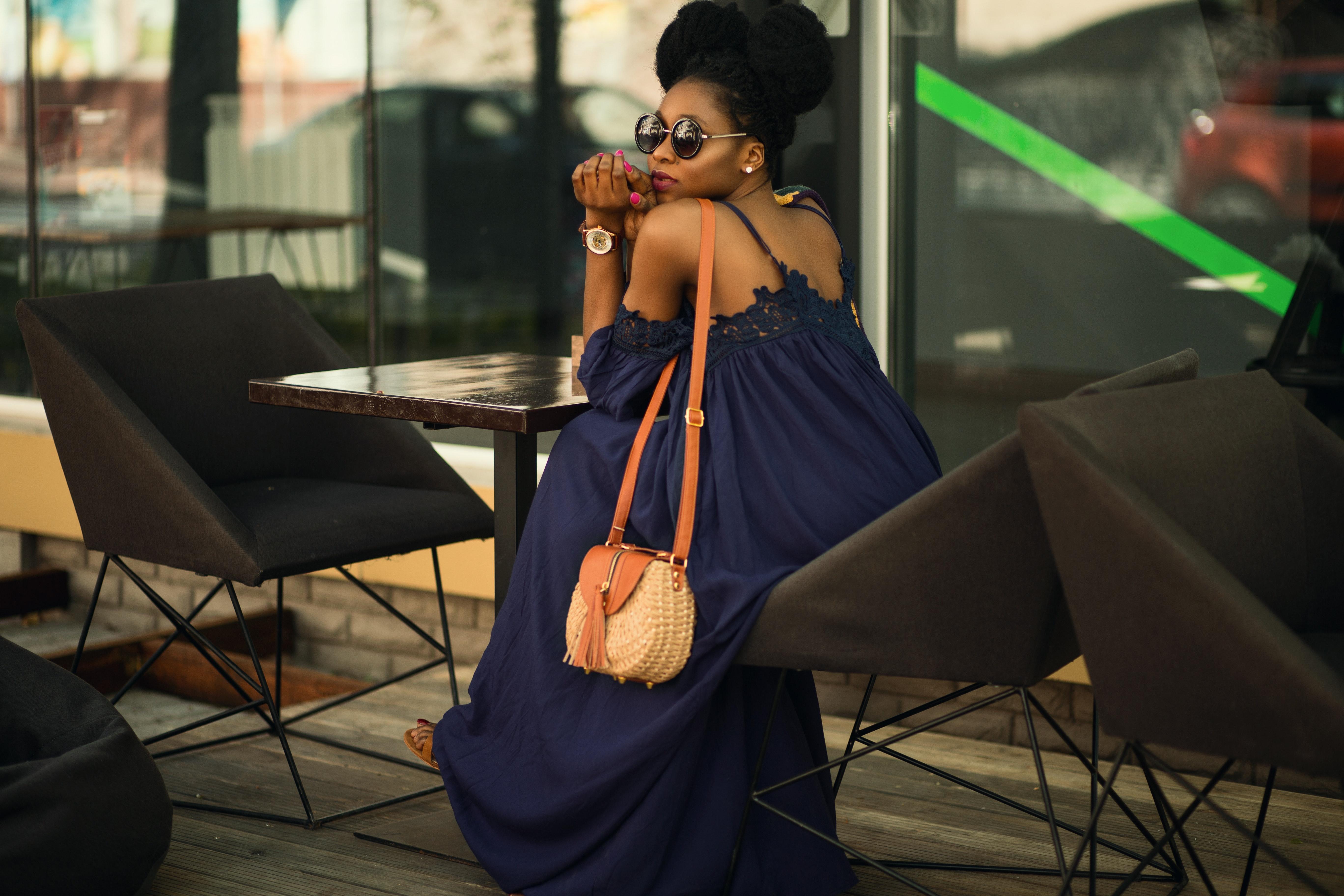 Woman wearing blue spaghetti strap dress photo