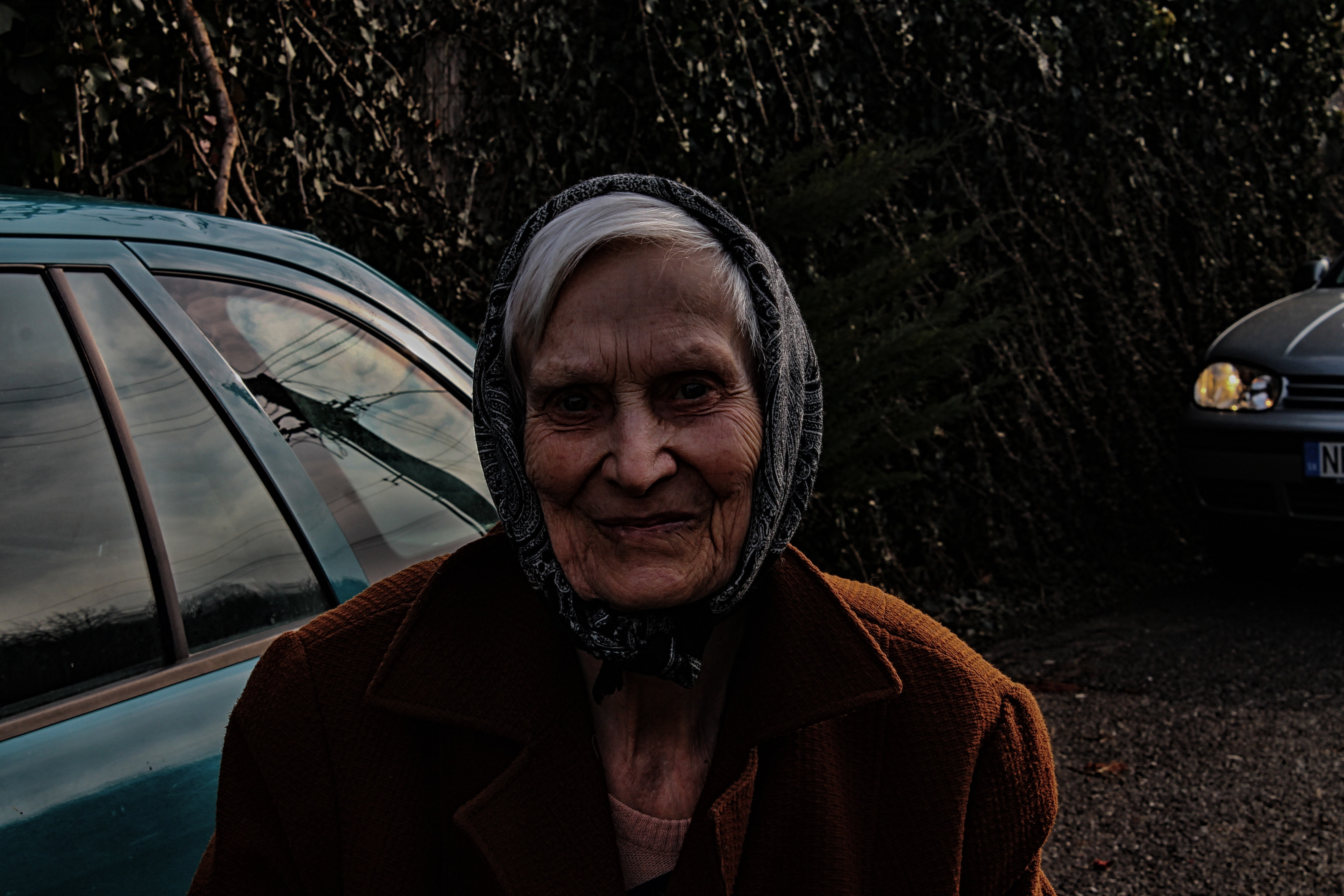 Woman wearing brown jacket and black head scarf photo