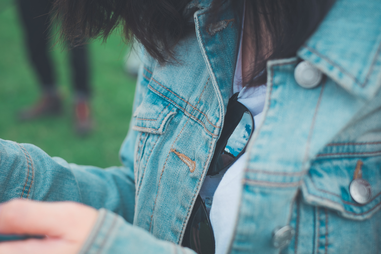 Woman wearing gray denim jacket photo