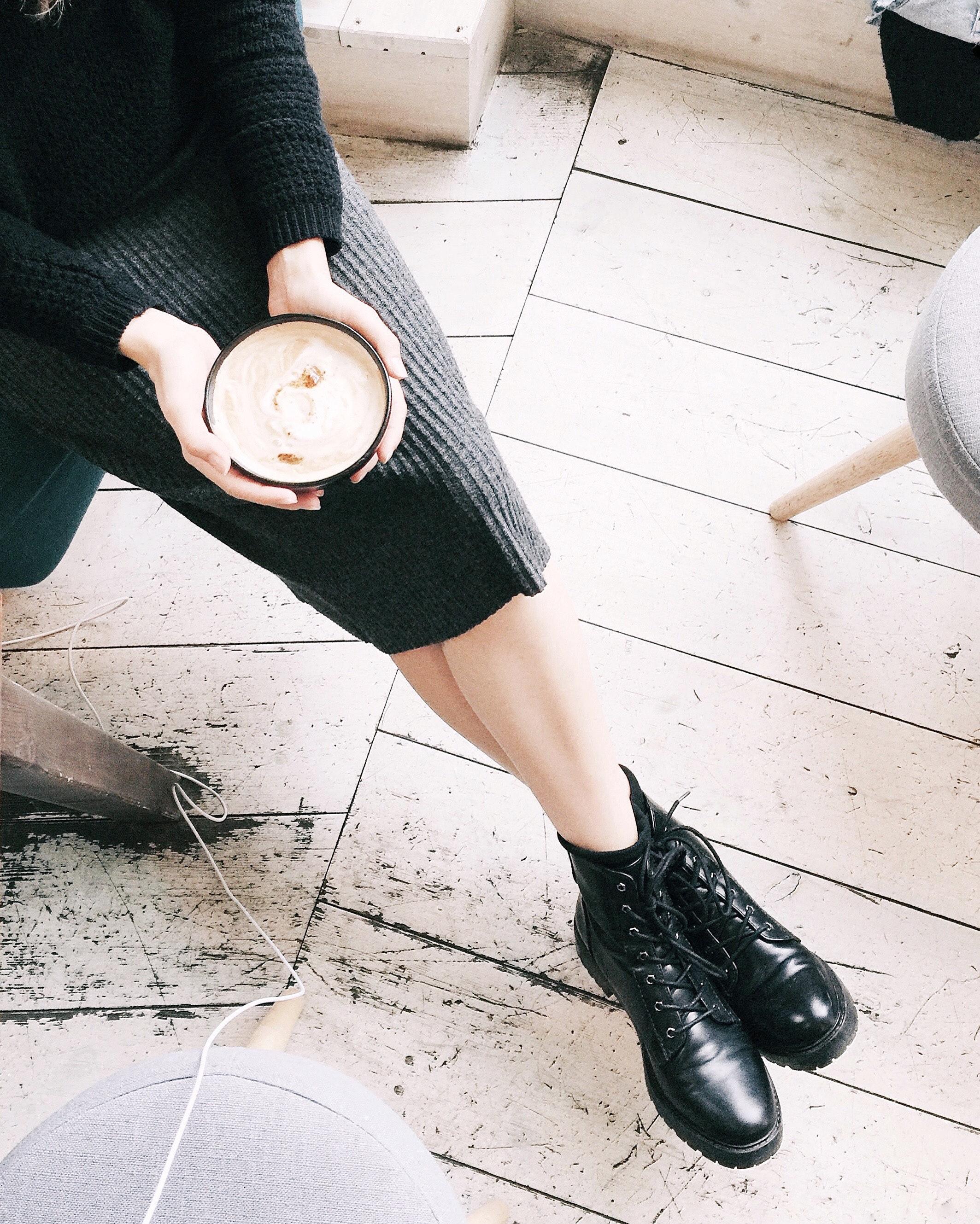 Woman wearing gray miniskirt holding black bowl photo