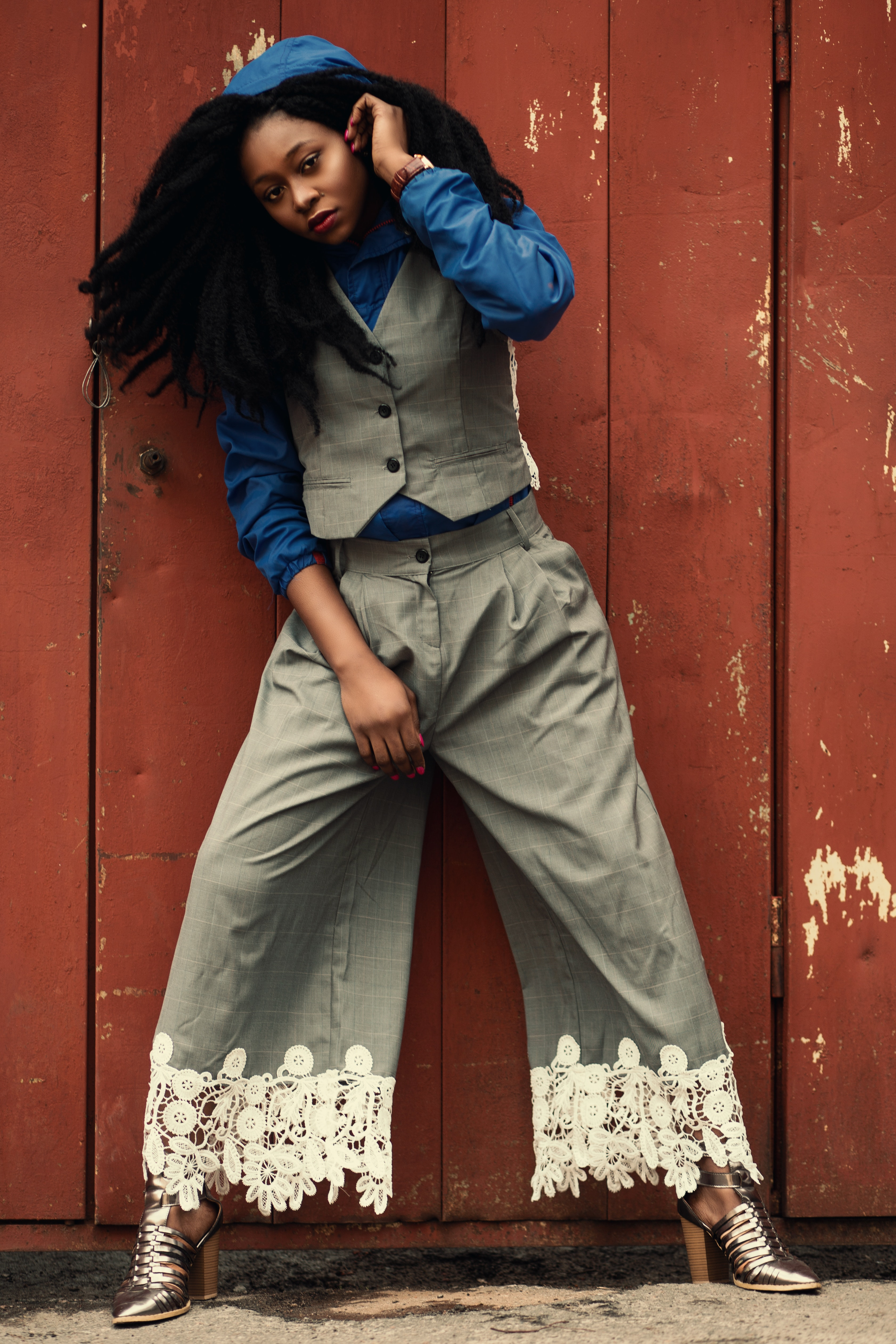 Woman wearing gray waist vest and gray flare pants photo