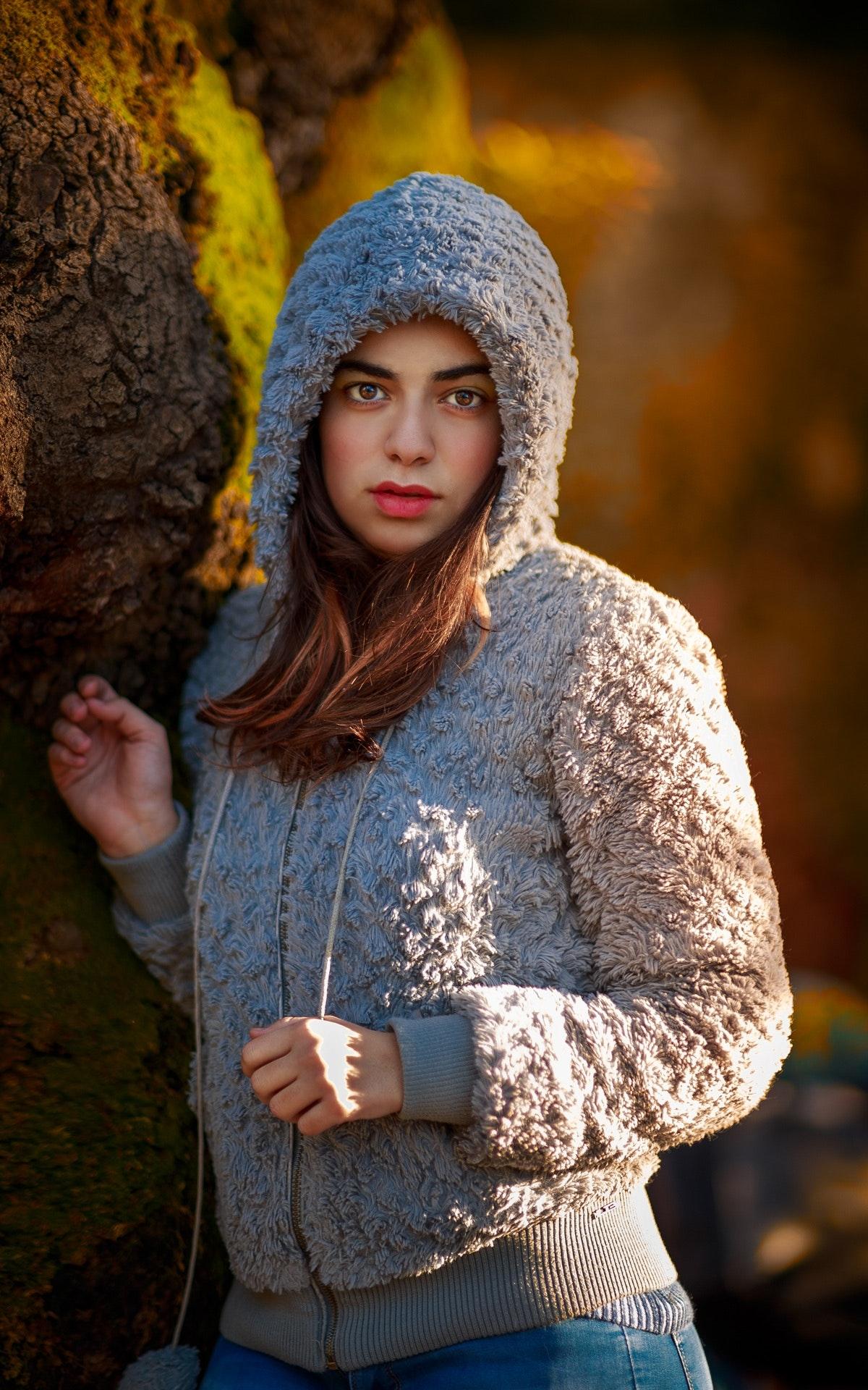 Woman wearing gray wool hoodie photo