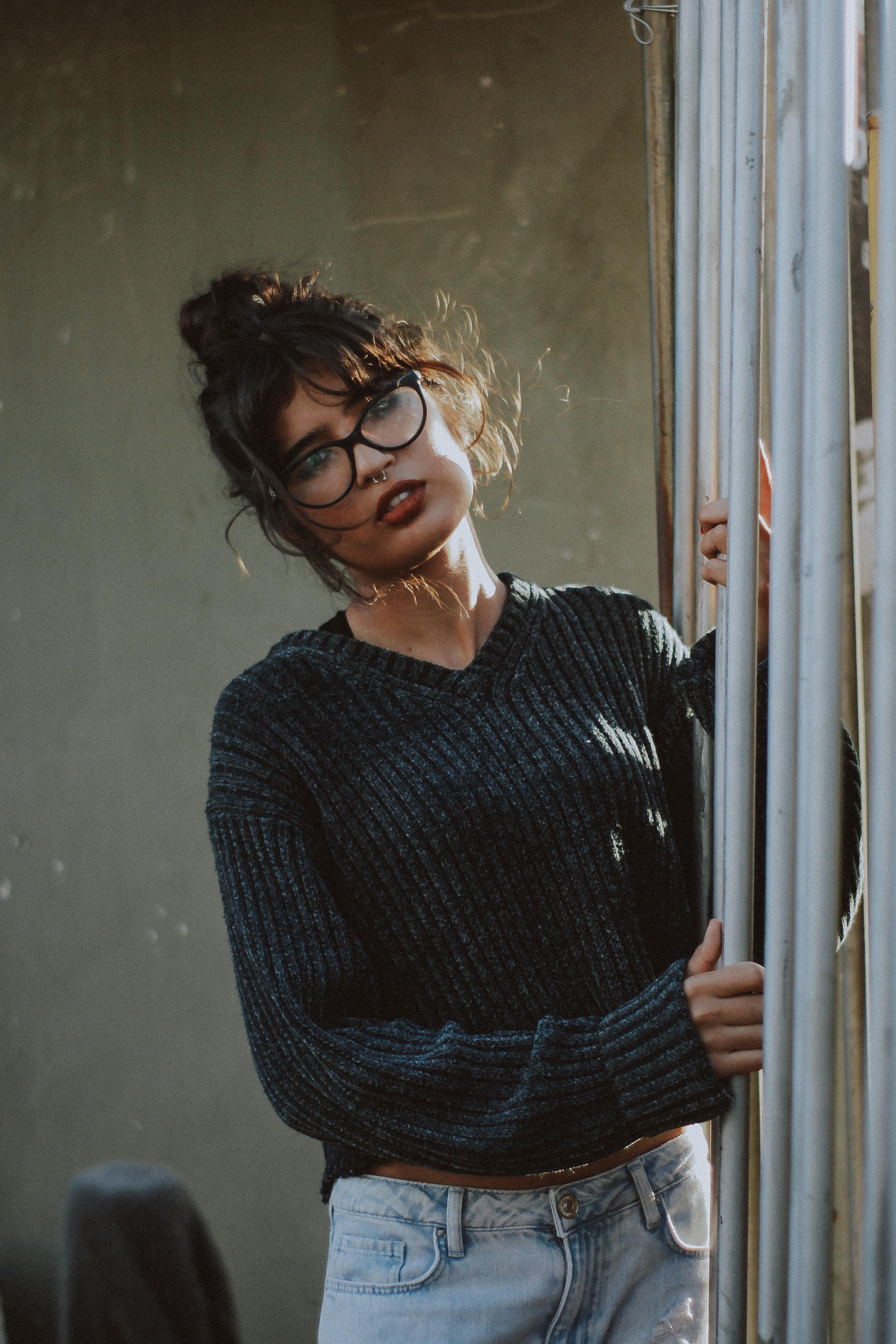Woman wearing grey corduroy sweater photo