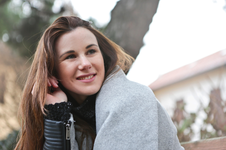 Woman wearing grey zip-up jacket photo