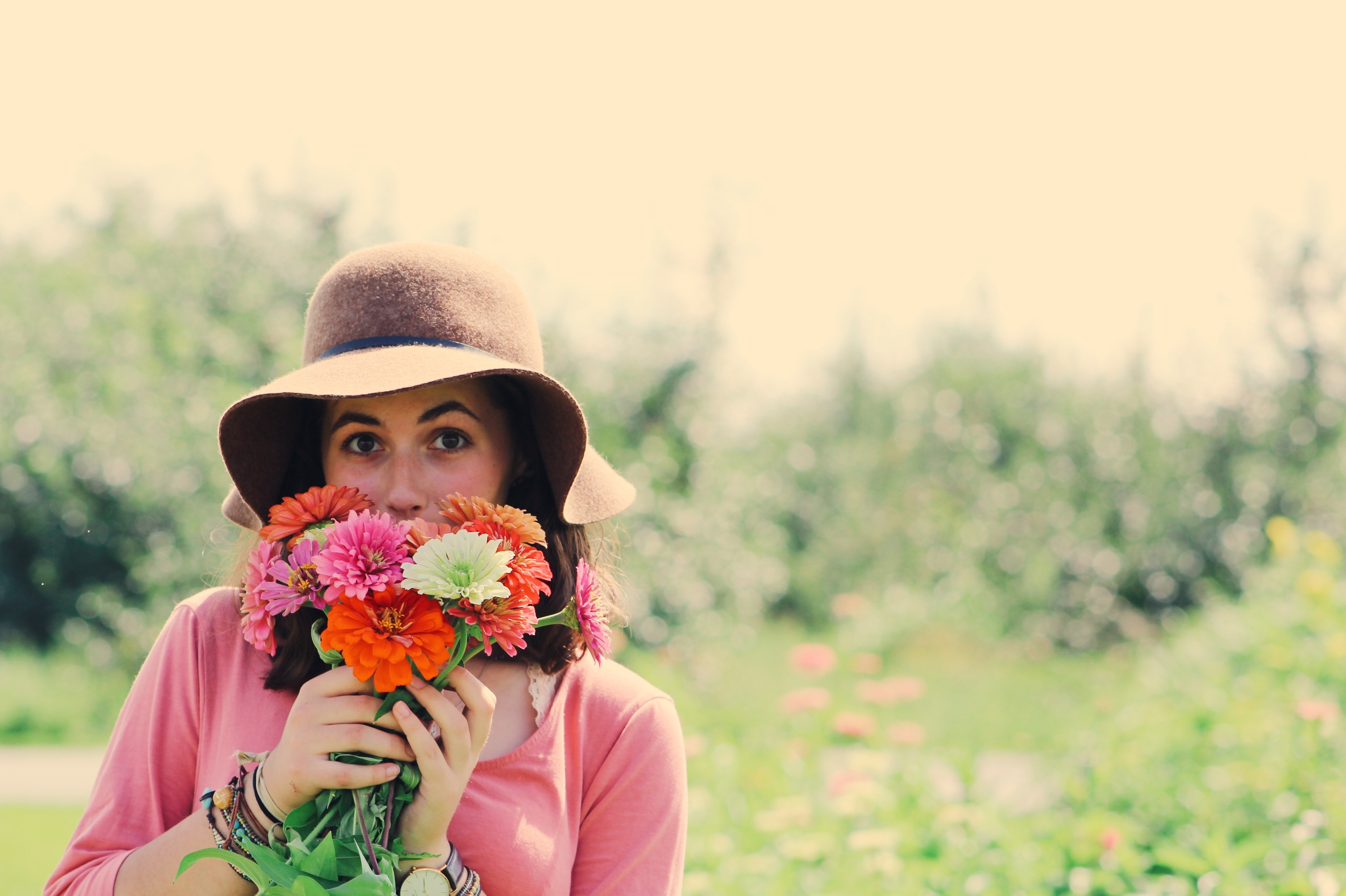 Woman Wearing Hat and Holding Flowers Surrounded by Plants, Beautiful, Happiness, Woman, Sun, HQ Photo