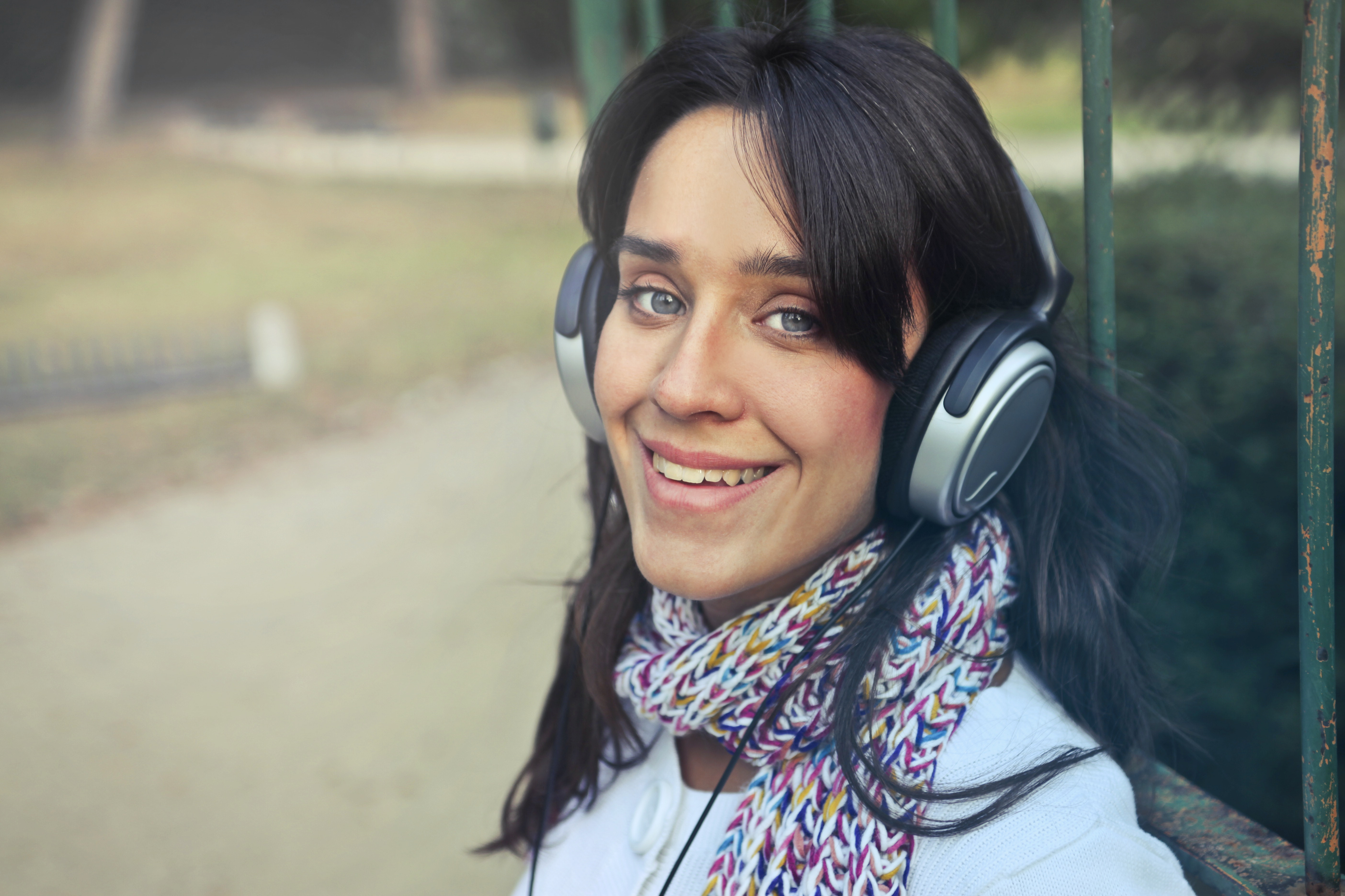 Woman wearing headphones with scarf photo