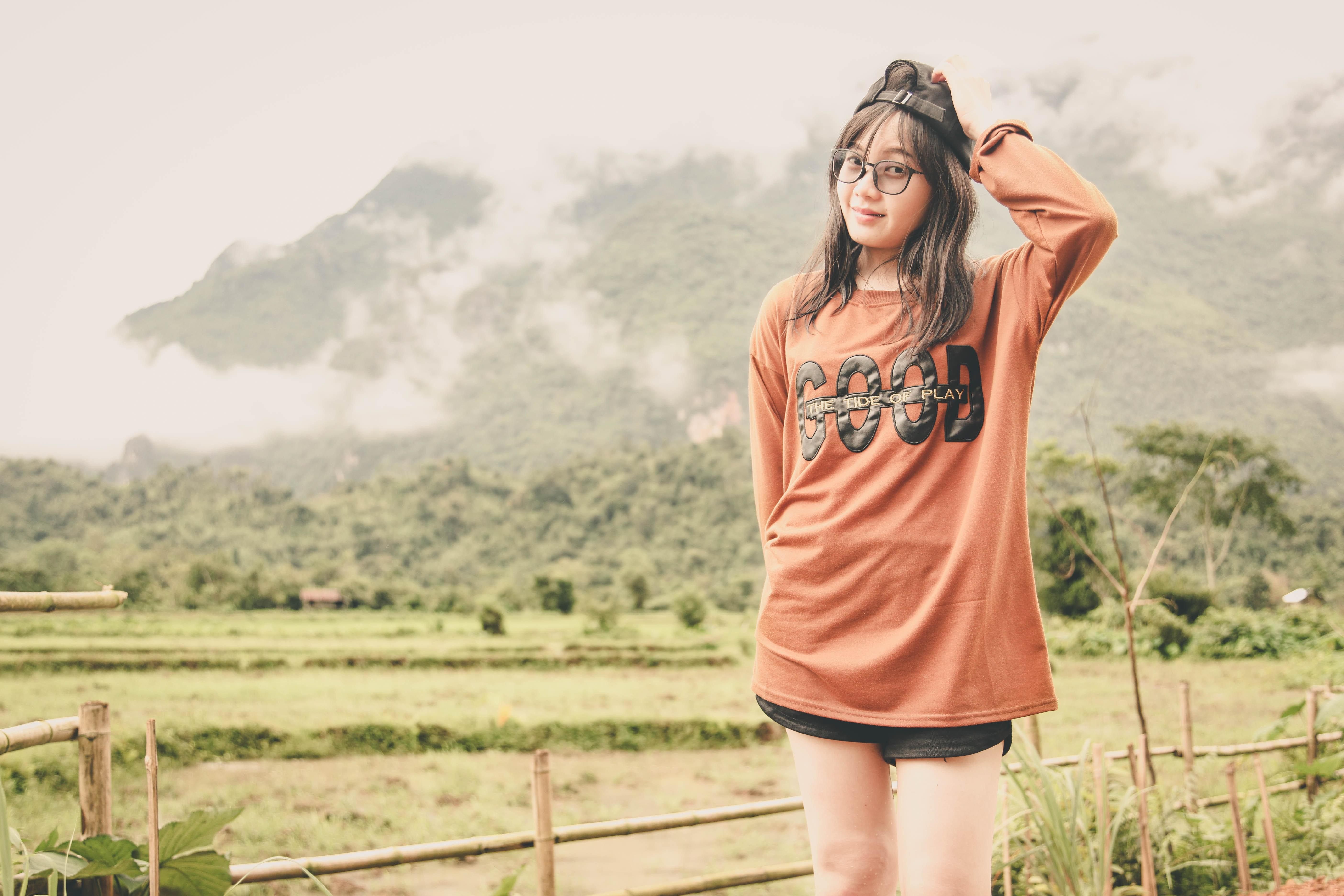 Woman wearing orange long-sleeved shirt photo