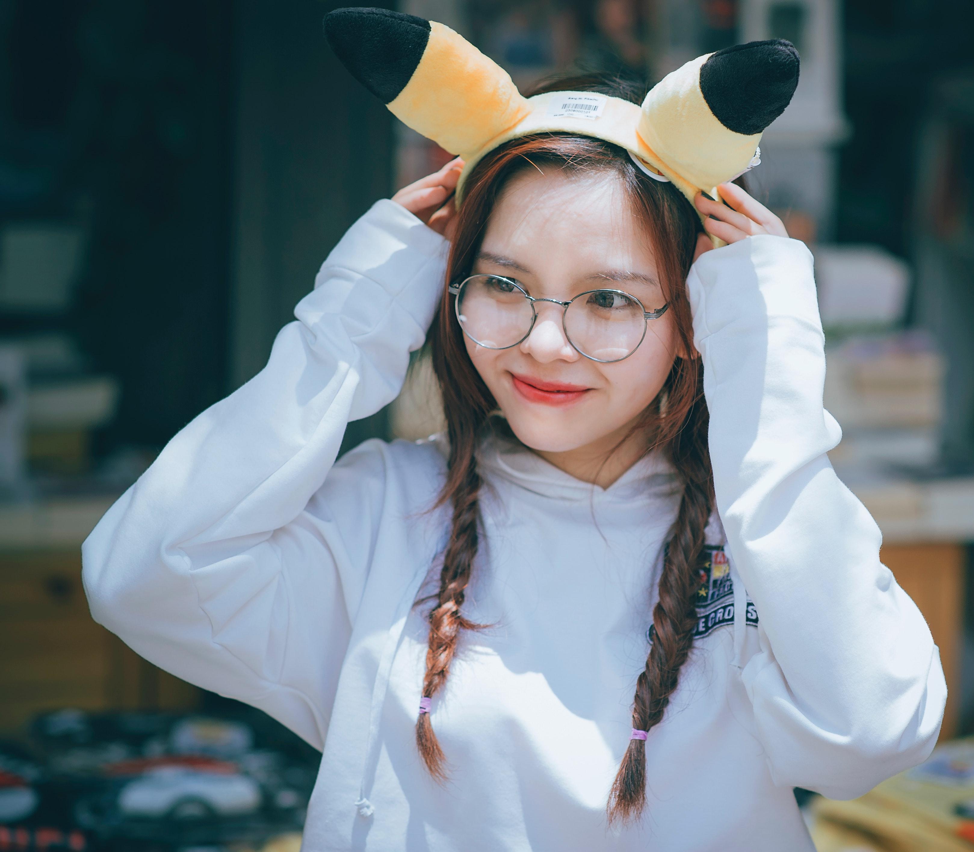 Woman wearing pikachu alice band photo