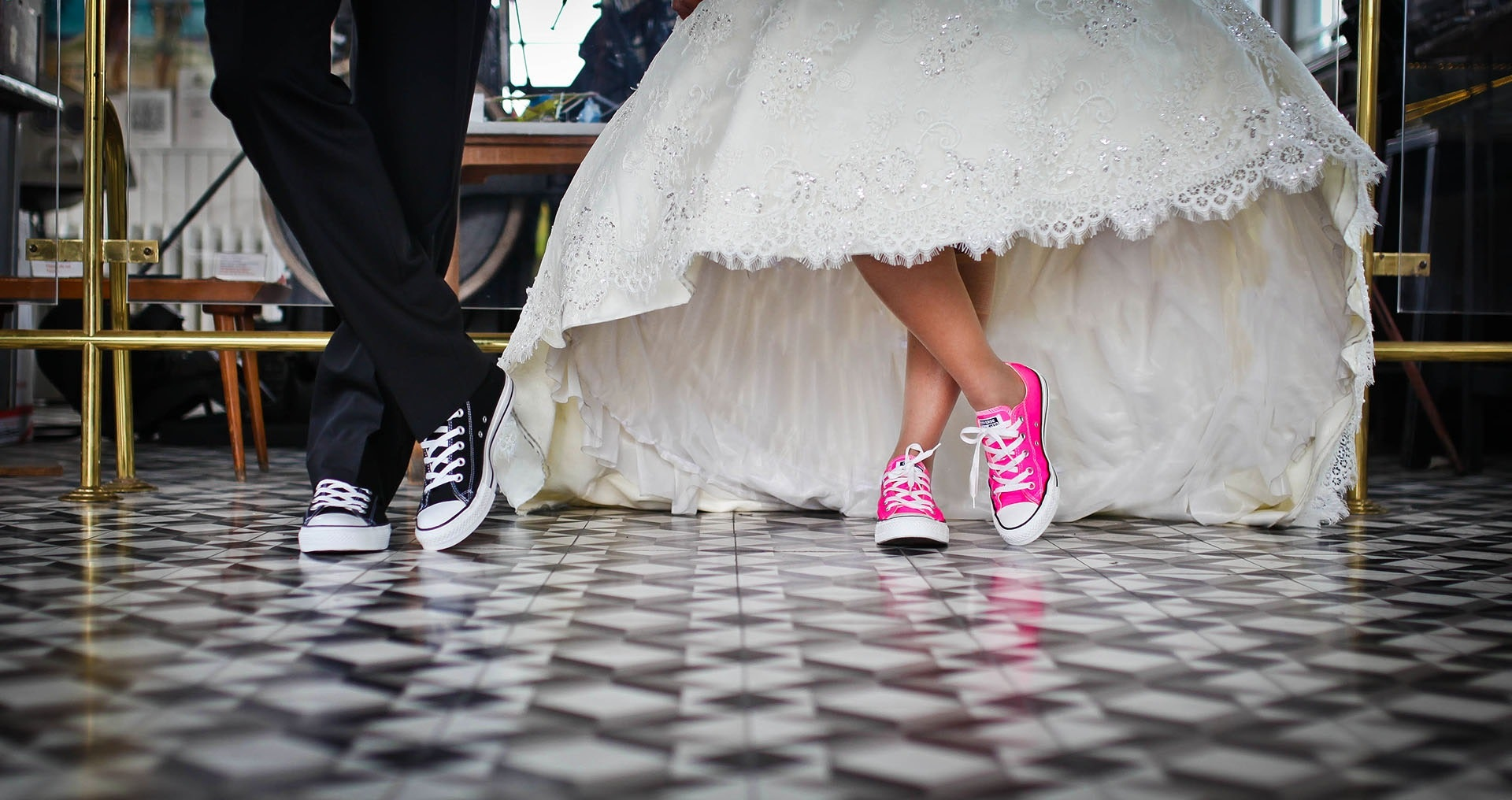 Woman wearing pink and white low top shoes dancing beside man photo