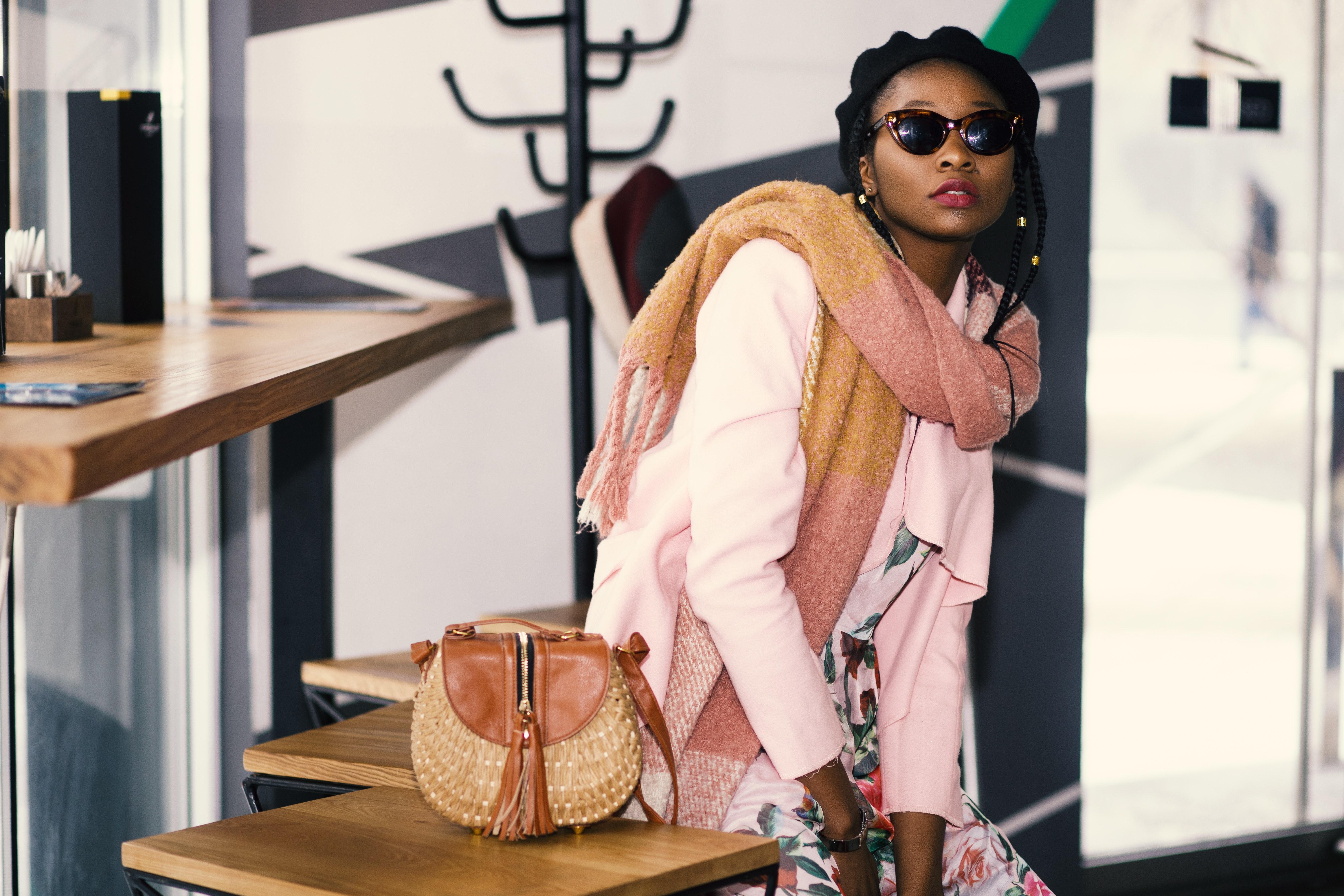Woman wearing pink cardigan photo