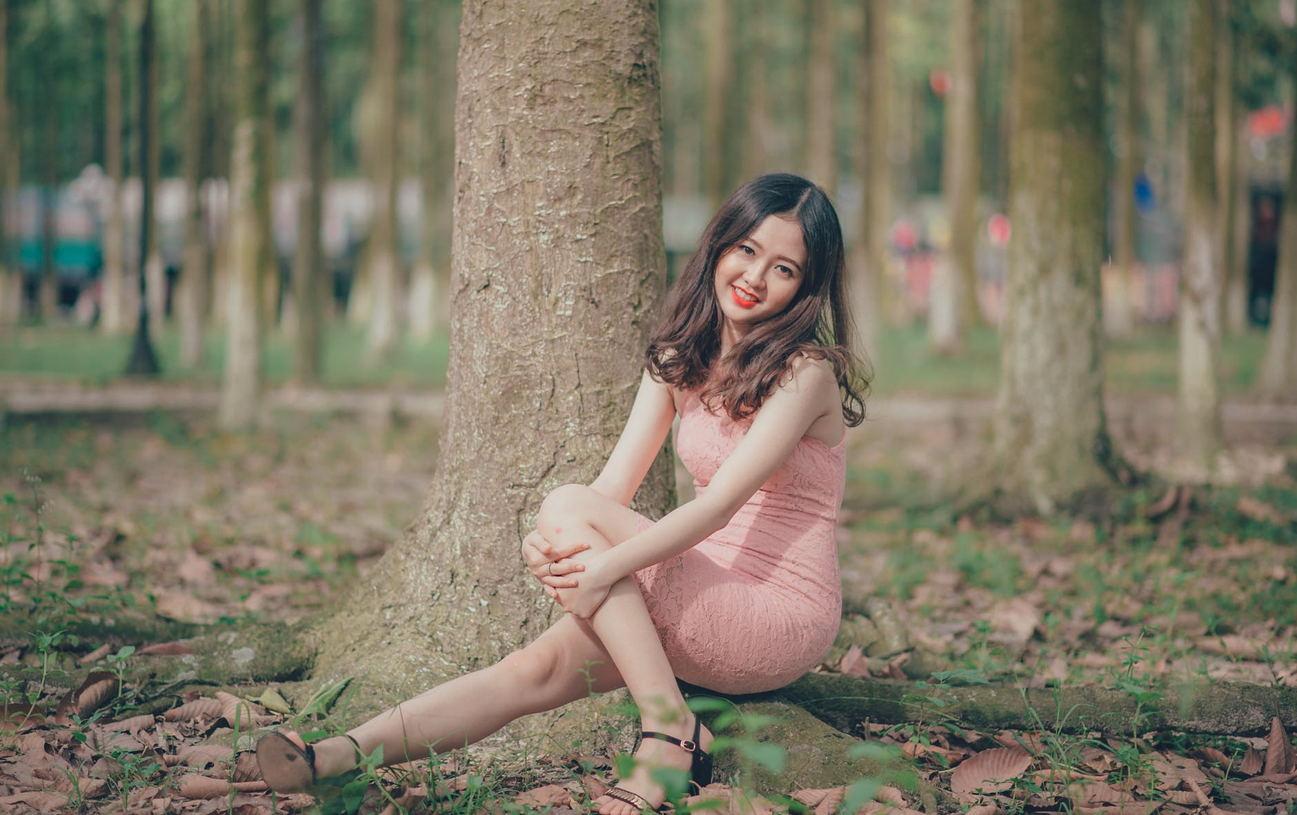 Woman wearing pink sleeveless dress photo