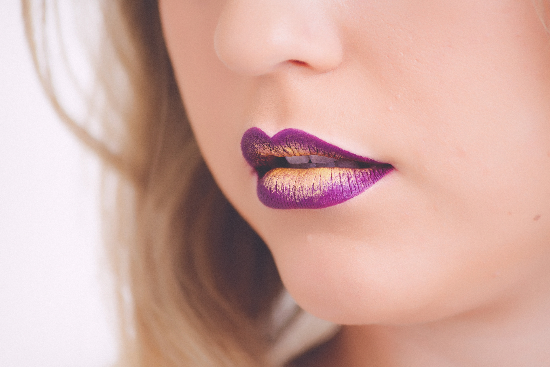 Woman wearing purple and beige lipstick photo