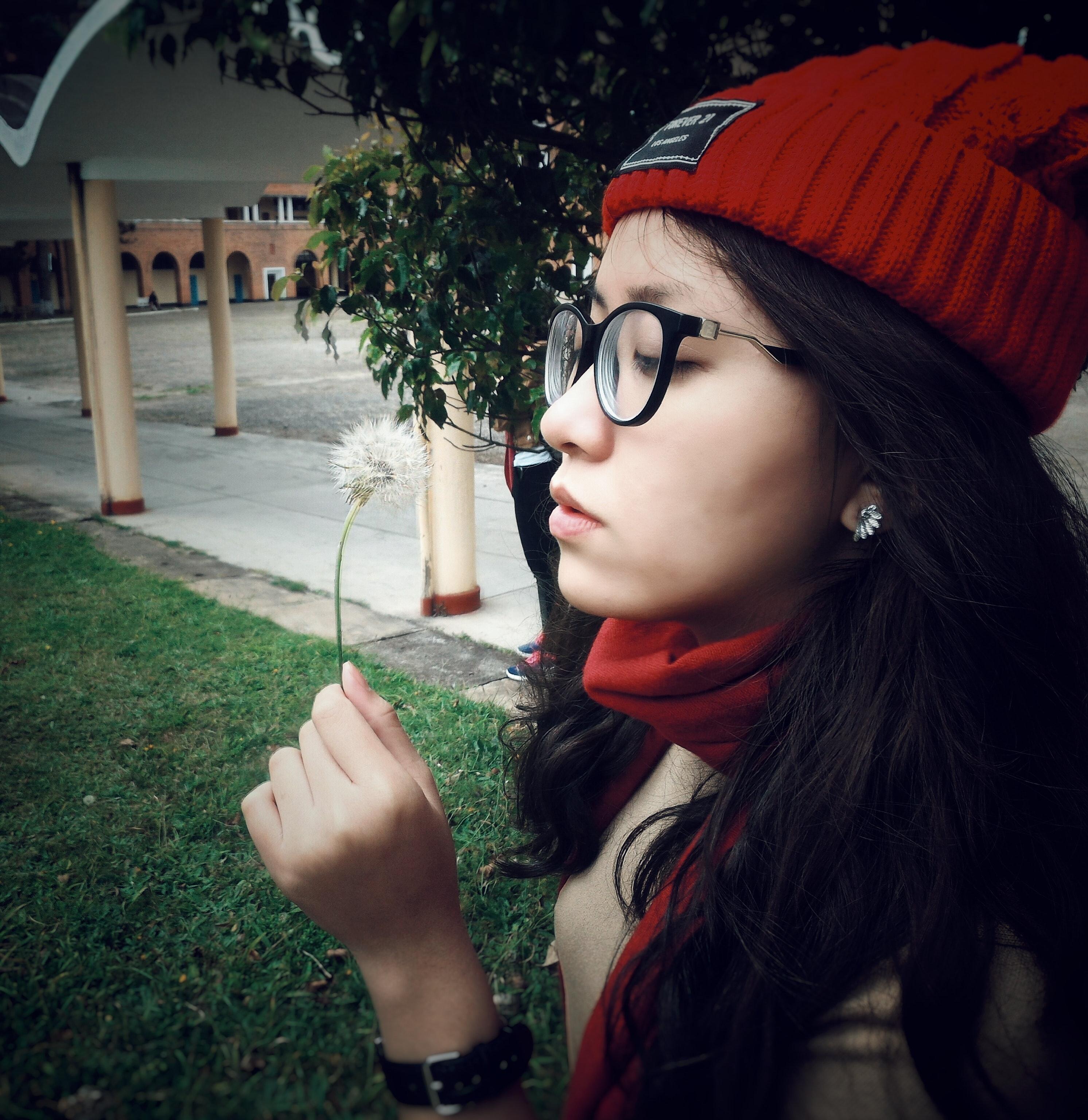 Woman wearing red beanie cap photo