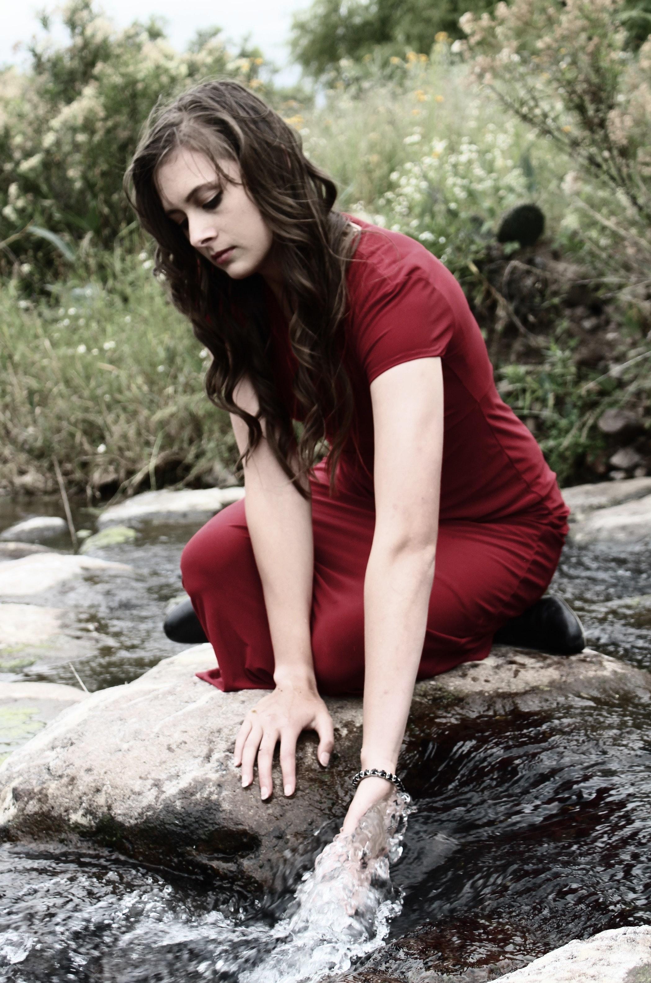 Woman wearing red crew neck bodycon maxi dress photo