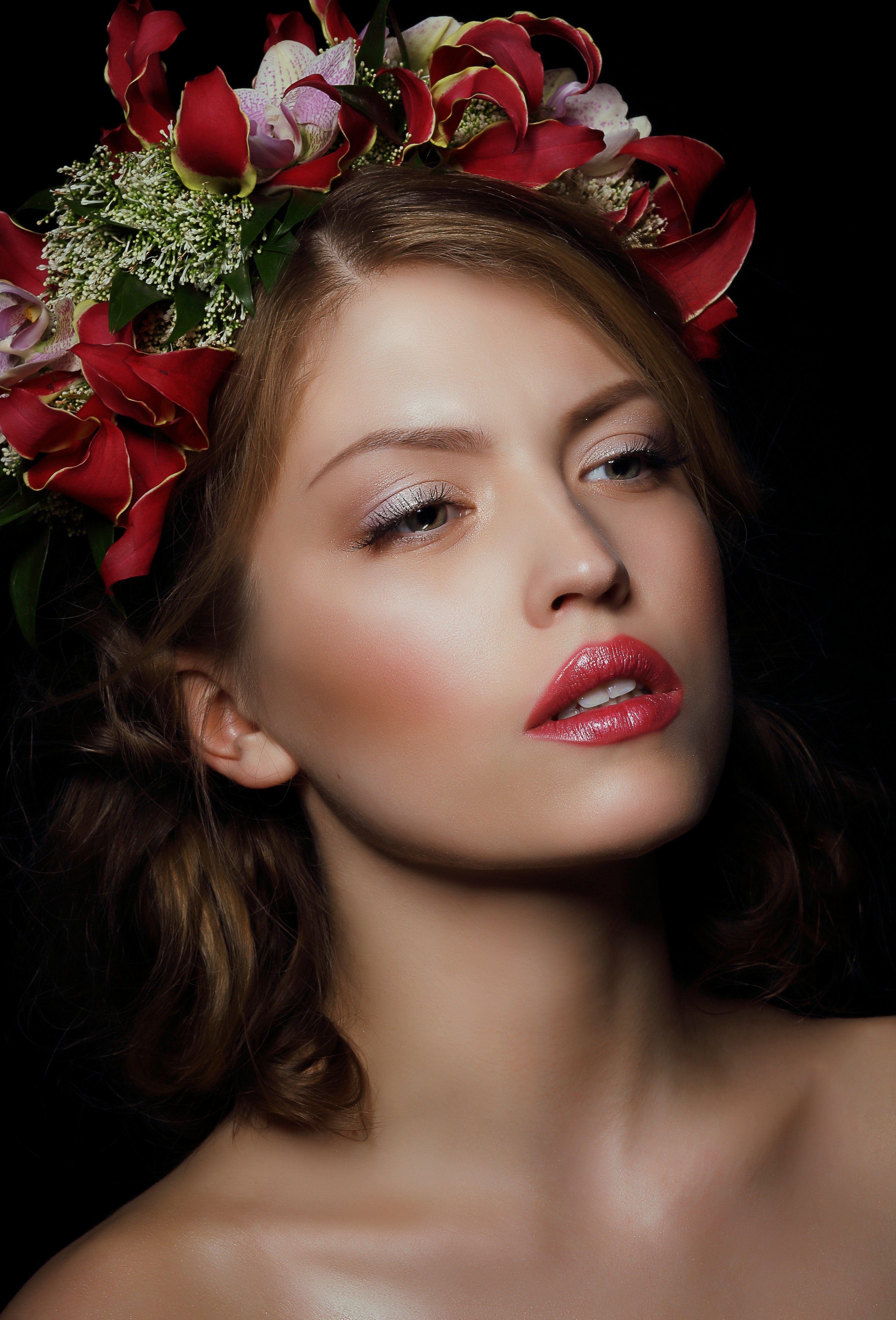 Woman wearing red floral headdress photo