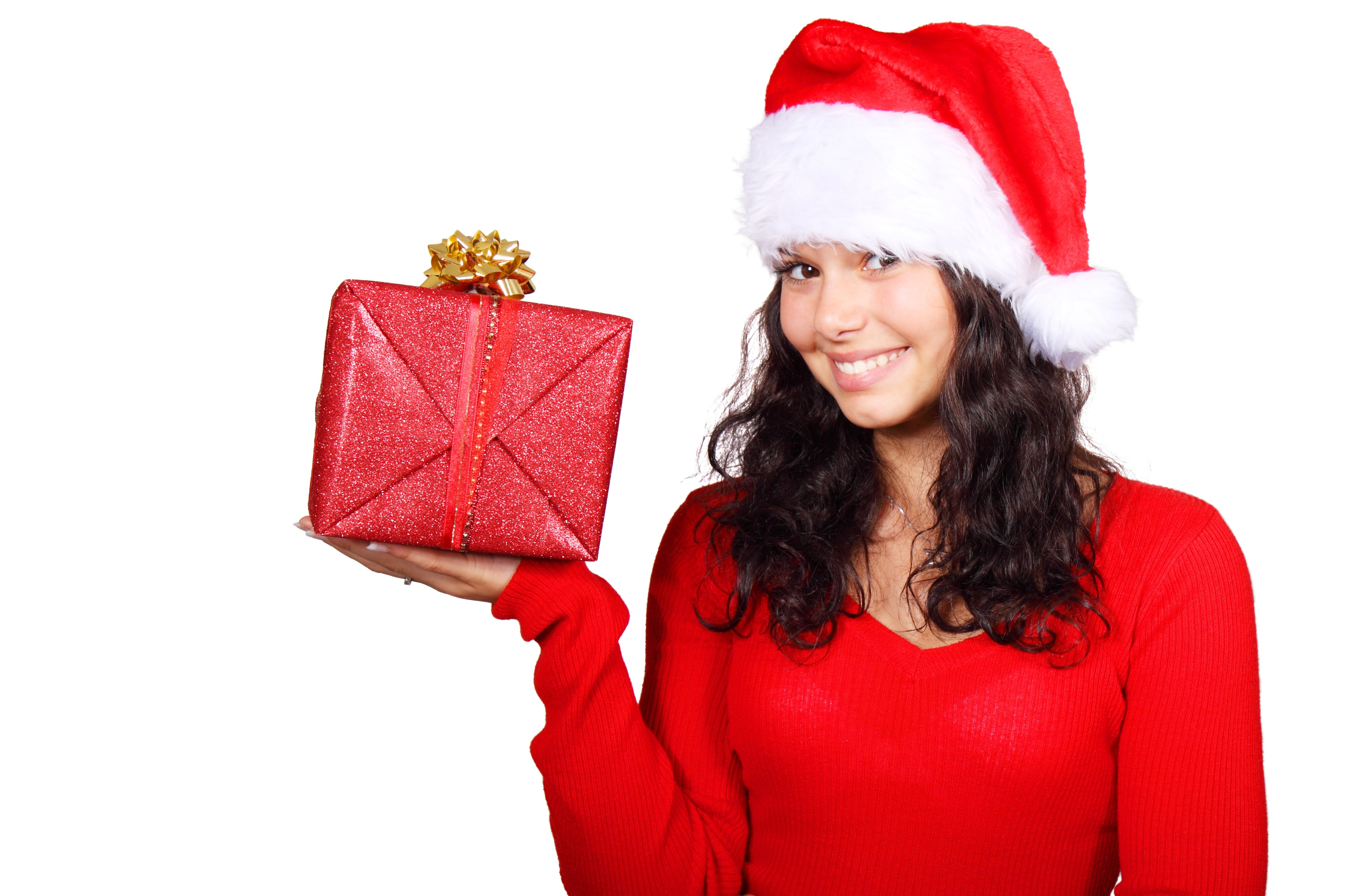 Woman wearing santa dress holding red and gold gift photo