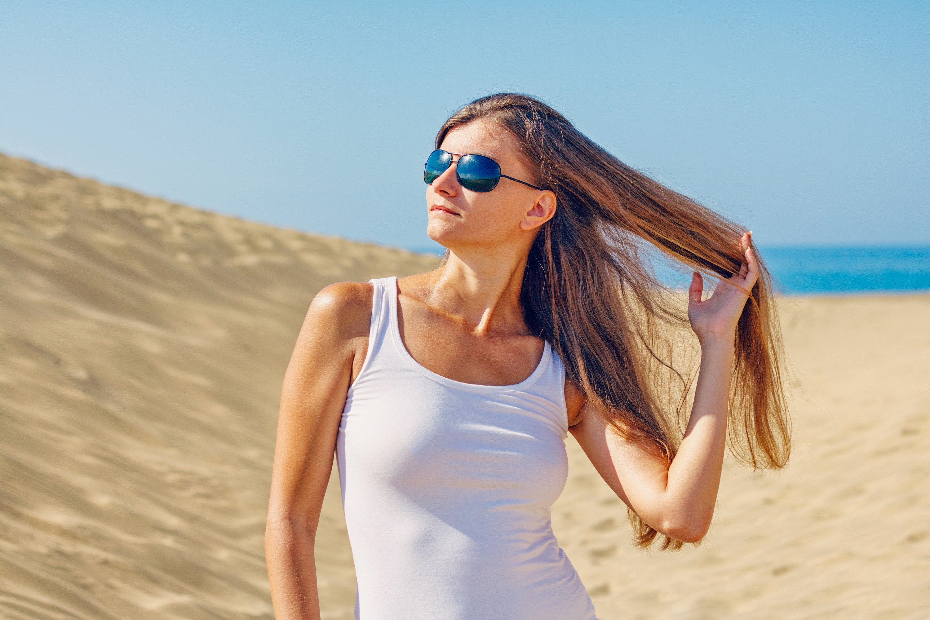 Woman wearing sunglasses at beach photo