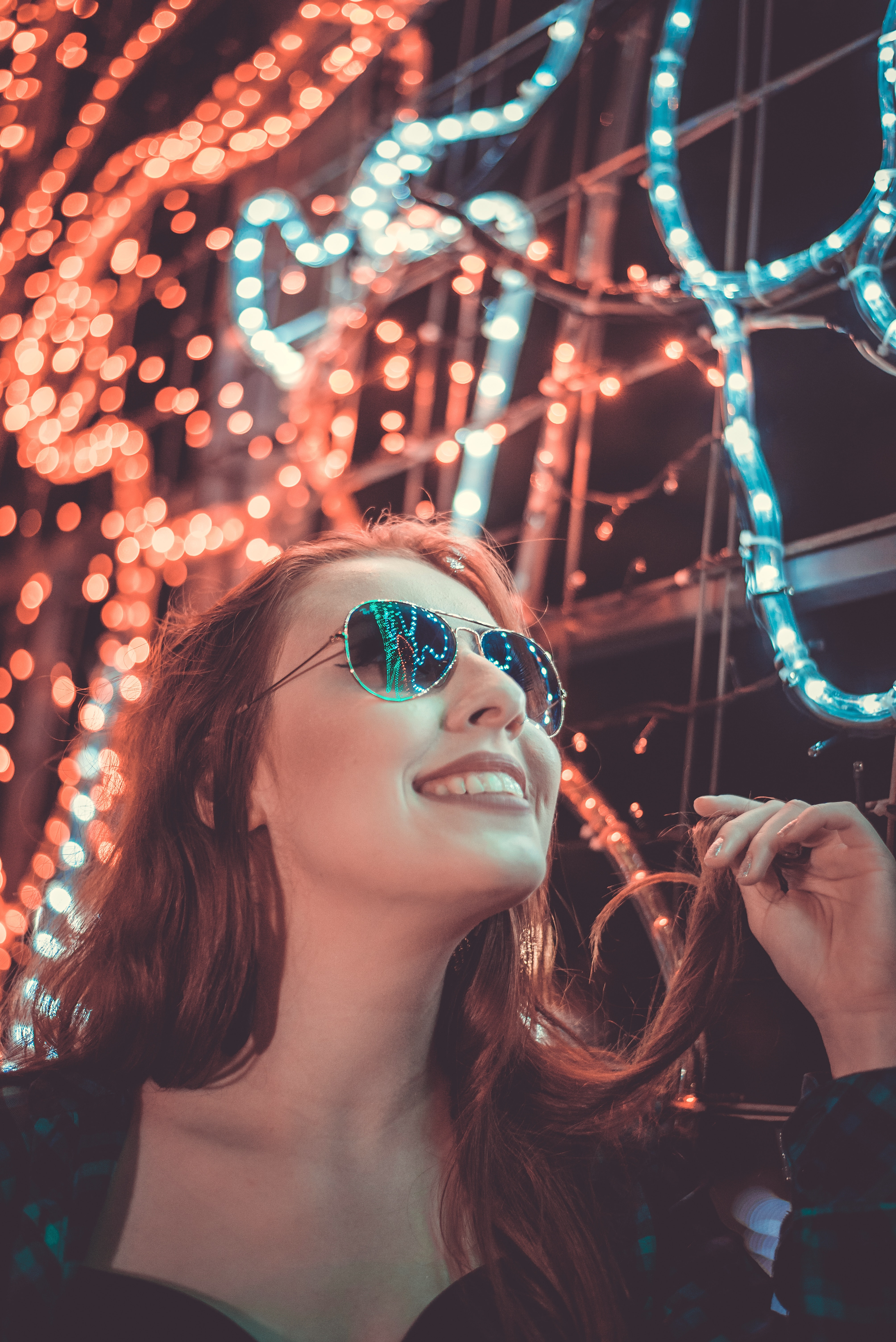 Woman wearing sunglasses holding her hair photo