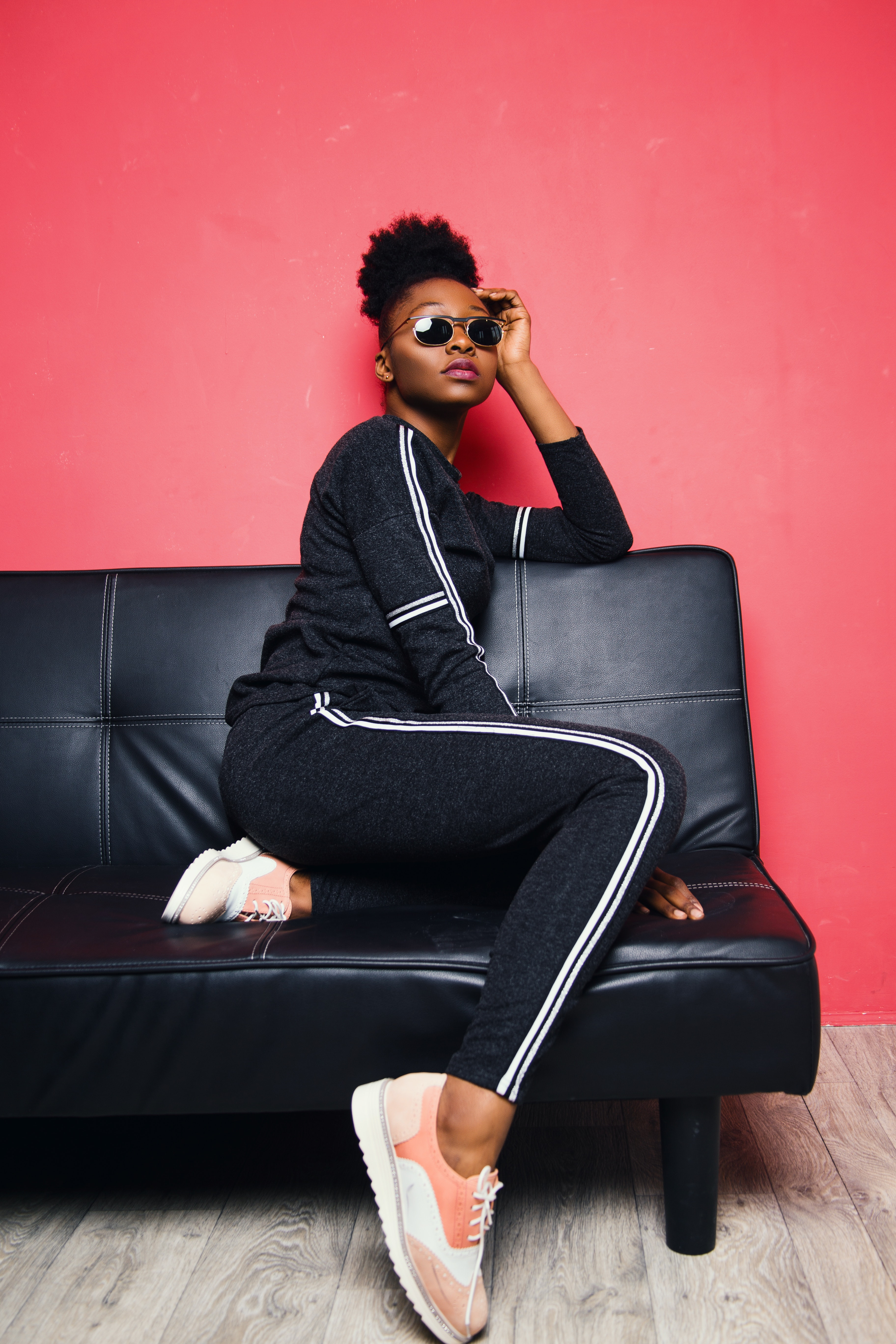 Woman Wearing Sunglasses Sits on Sofa Inside the Room, Adult, Pose, Red, Seat, HQ Photo