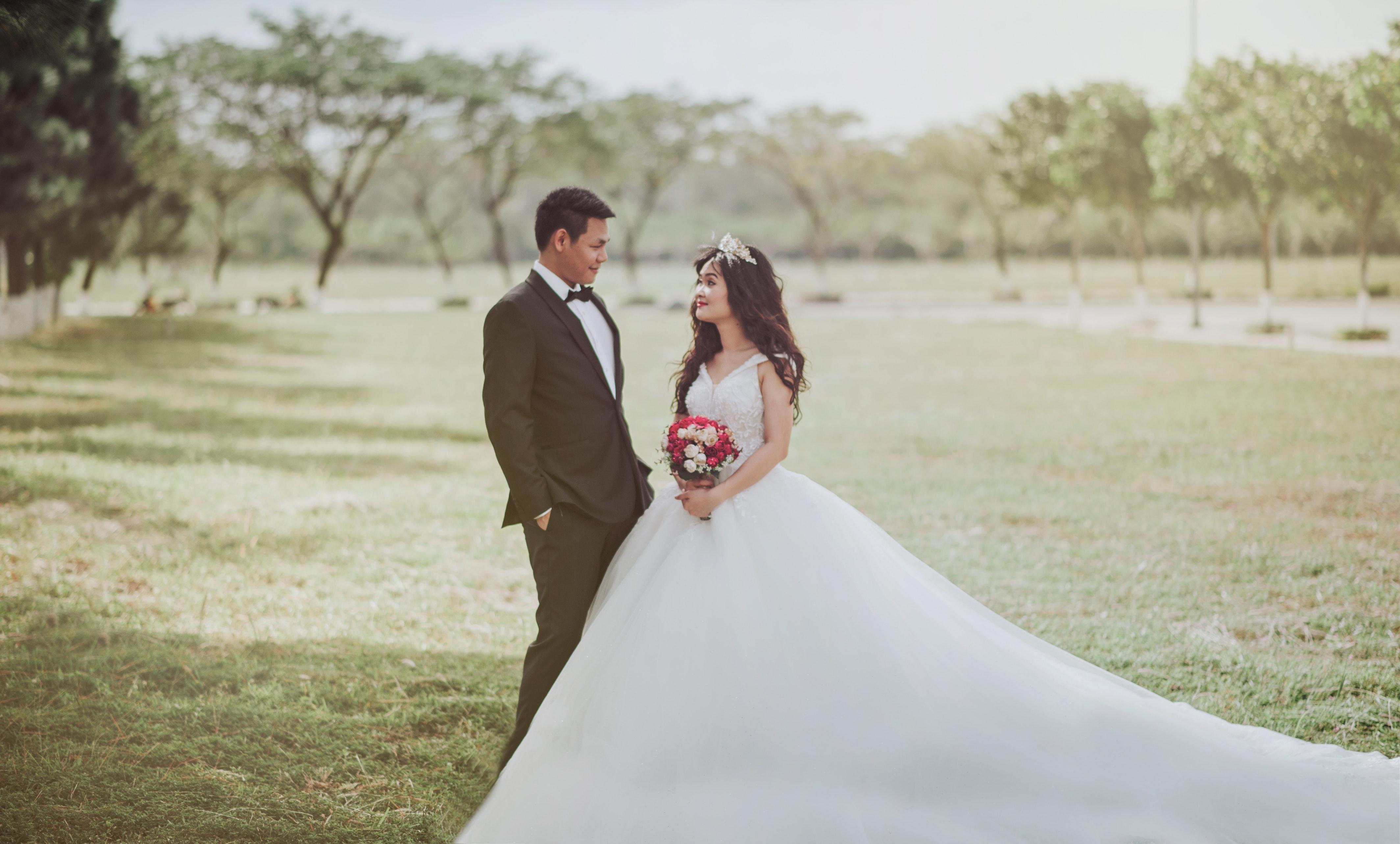 Free photo: Woman Wearing Wedding Dress Standing Beside a Man ...