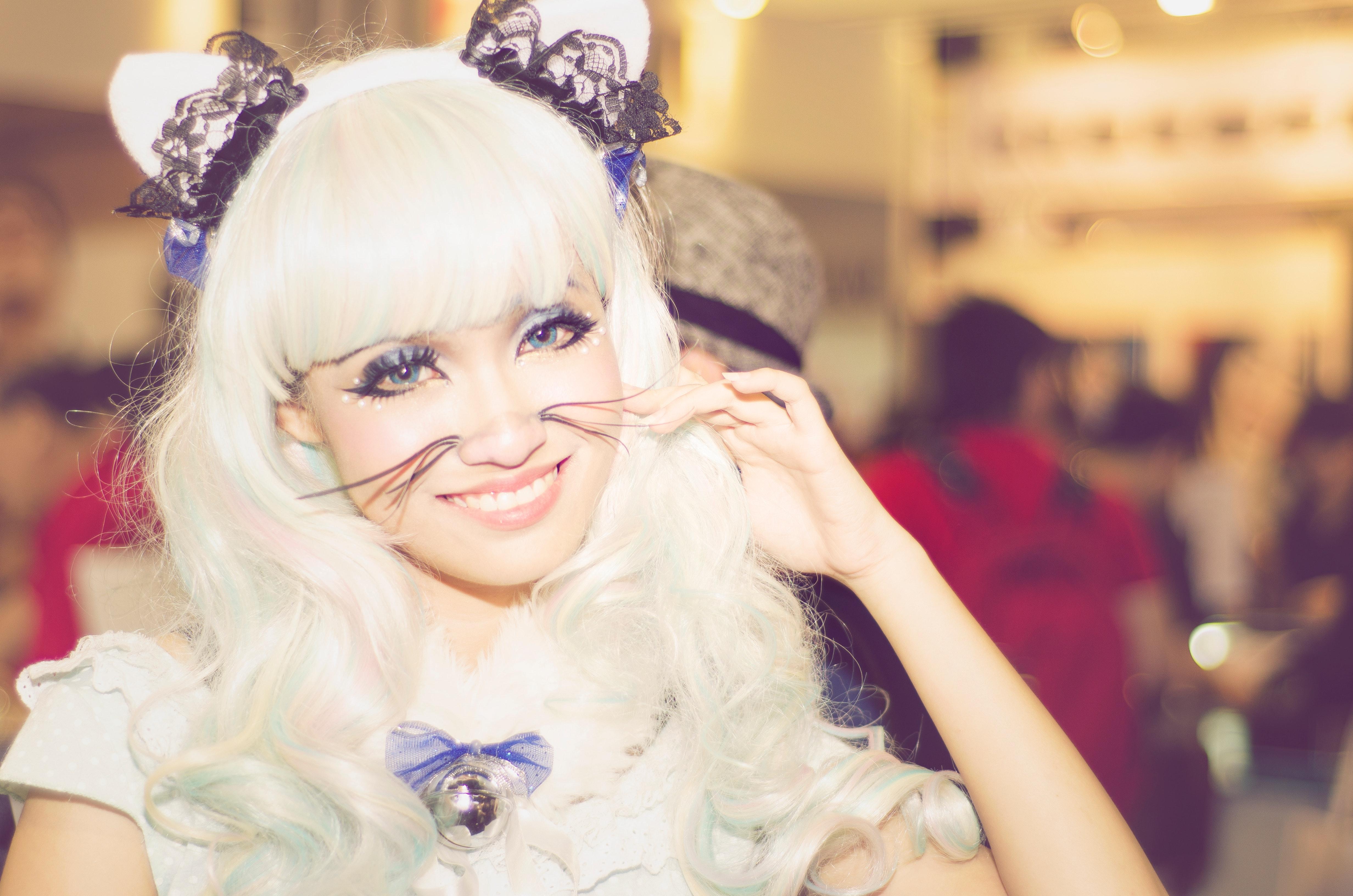 Woman wearing white anime character costume photo