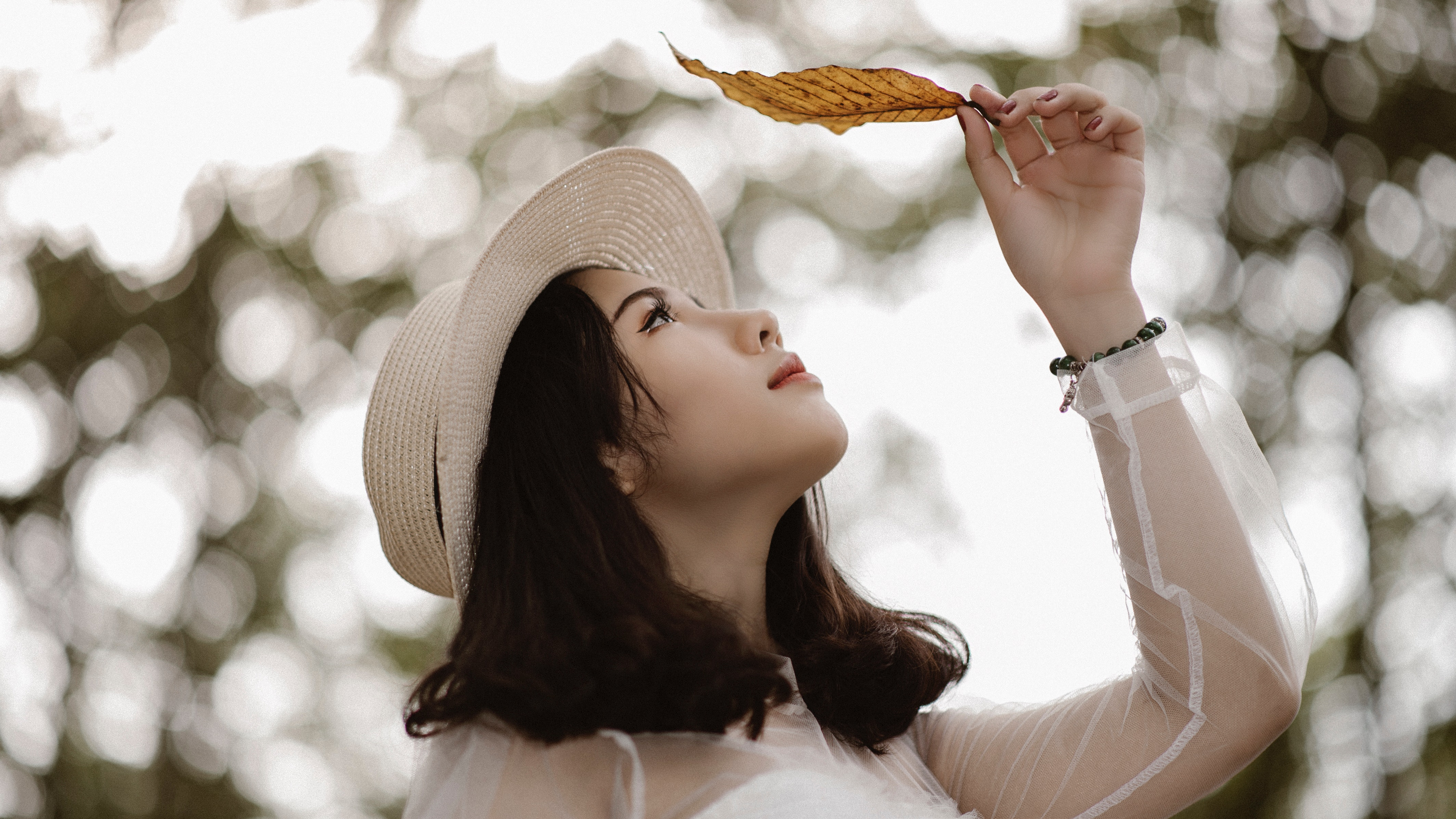 Woman Wearing White Long Sleeve Scoop-neck Top While Holding Brown Leaf, Leaf, Young, Woman, Wear, HQ Photo