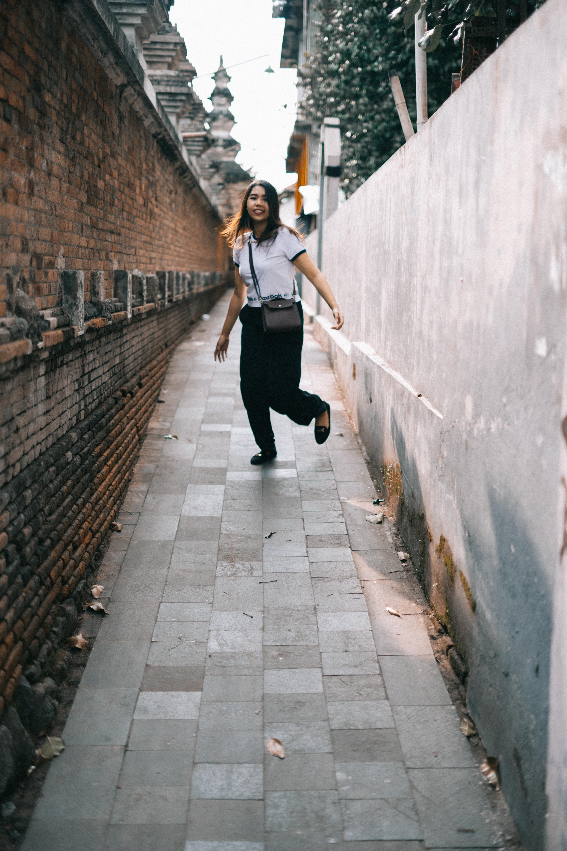 Woman wearing white shirt and black pants photo