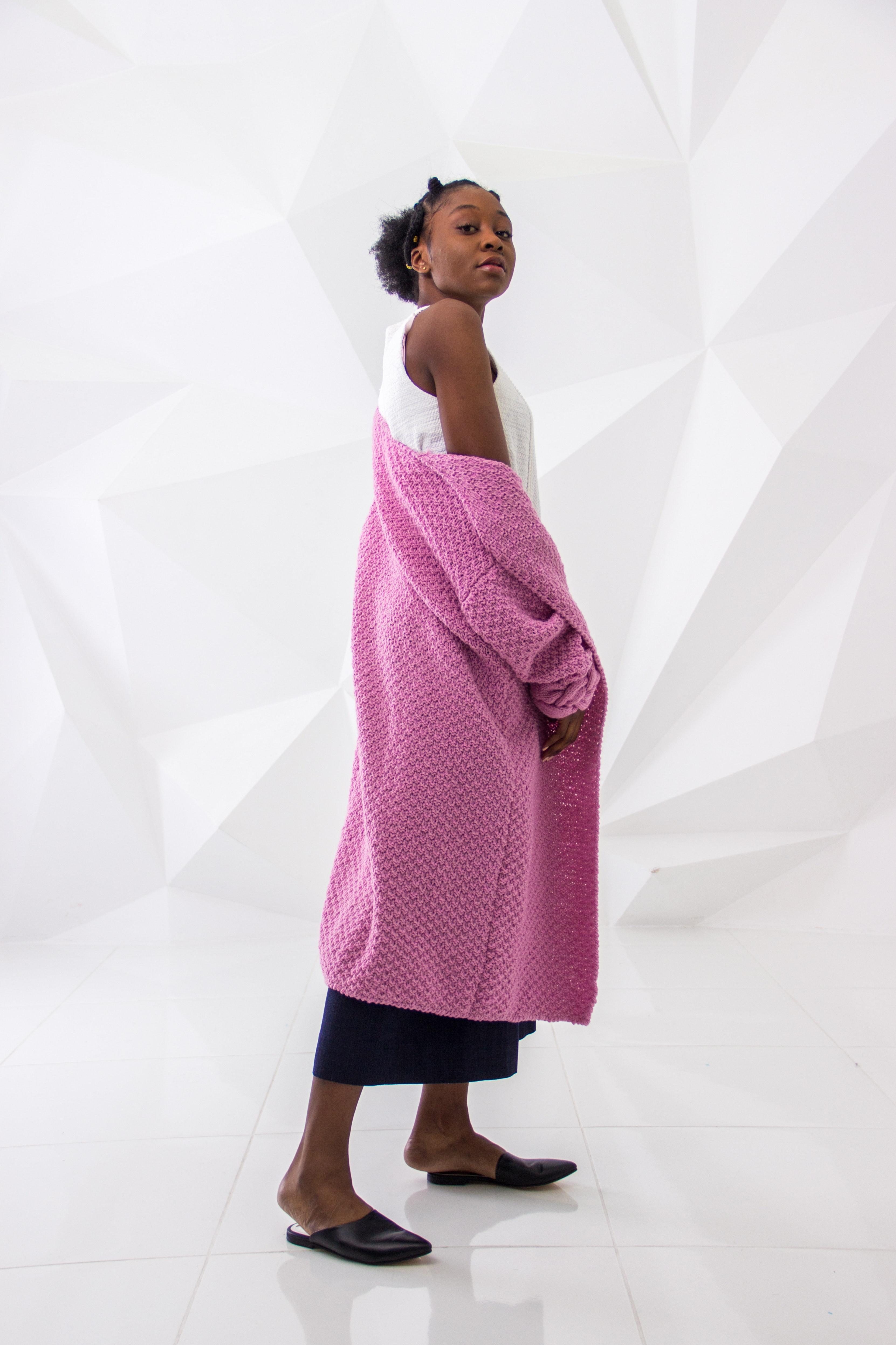 Woman wearing white sleeveless dress and pink long coa photo
