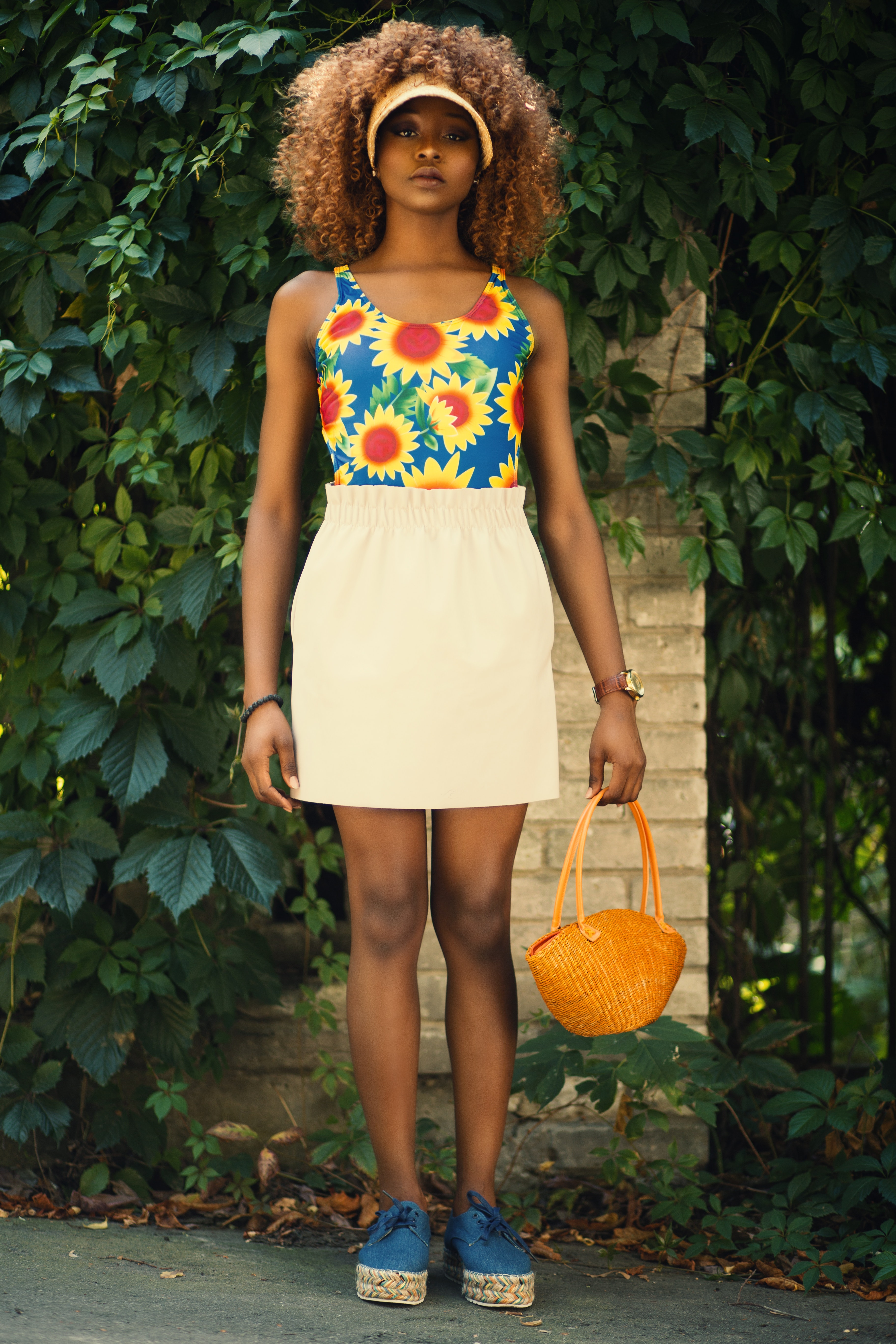 Woman wearing yellow and blue floral crop top photo