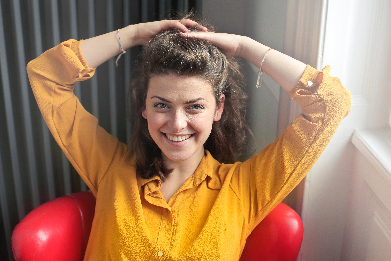 Woman wearing yellow button-up long-sleeved dress shirt photo