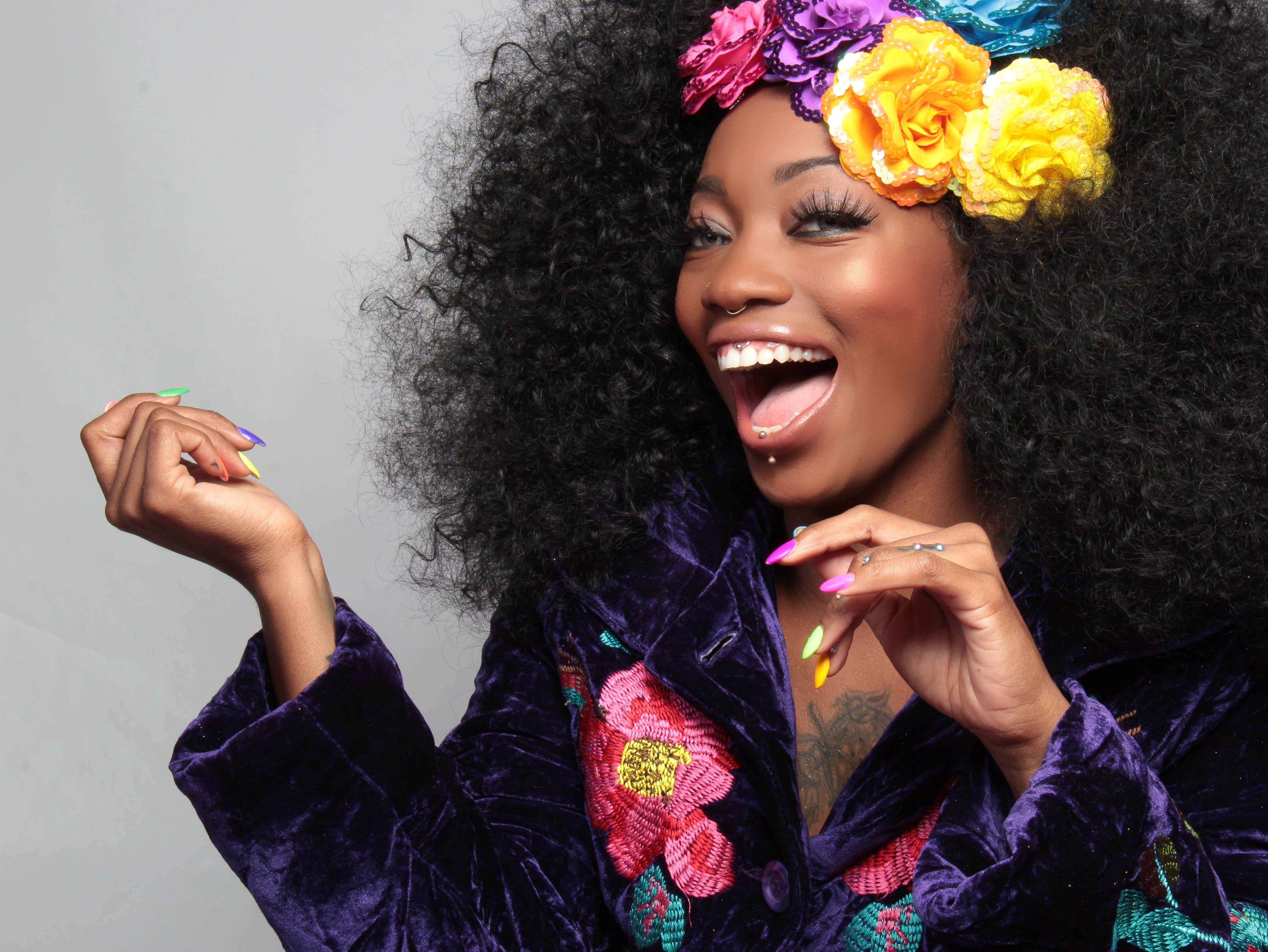 Woman wearing yellow purple and blue flower hair clipper photo