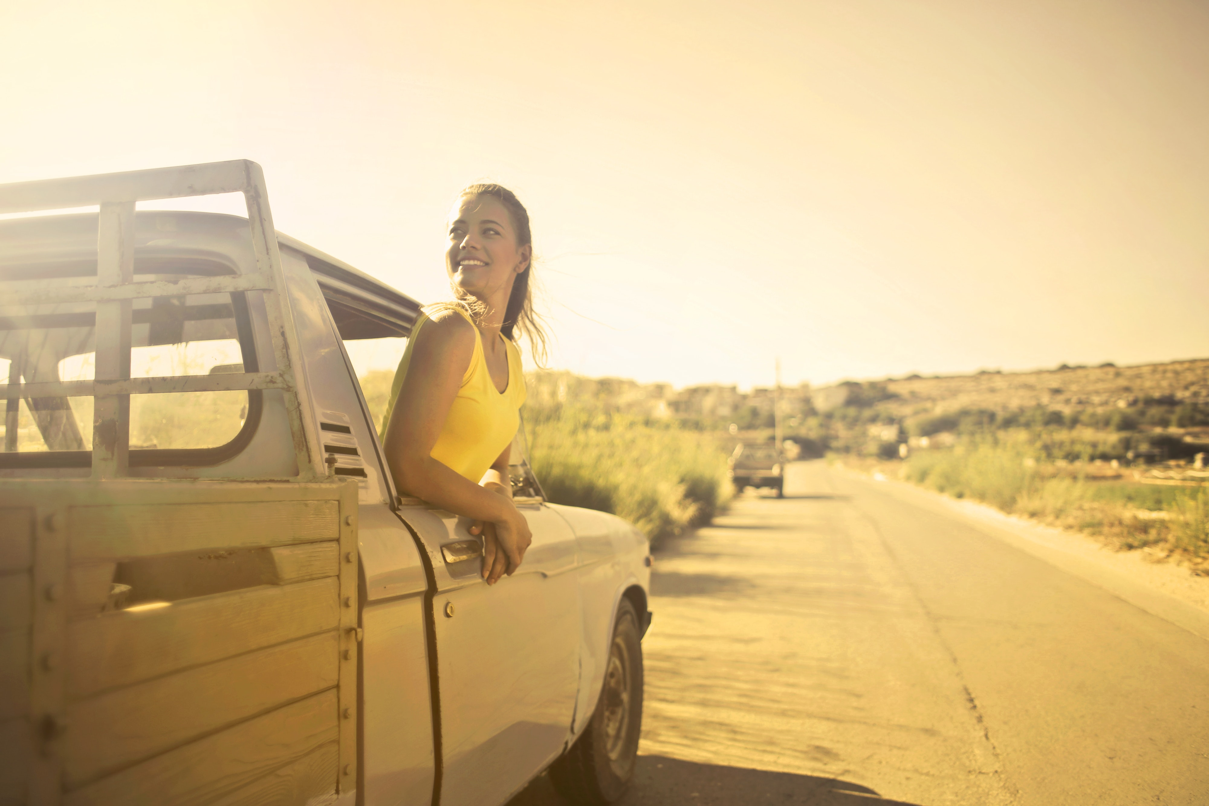 Woman wearing yellow shirt inside pickup truck photo