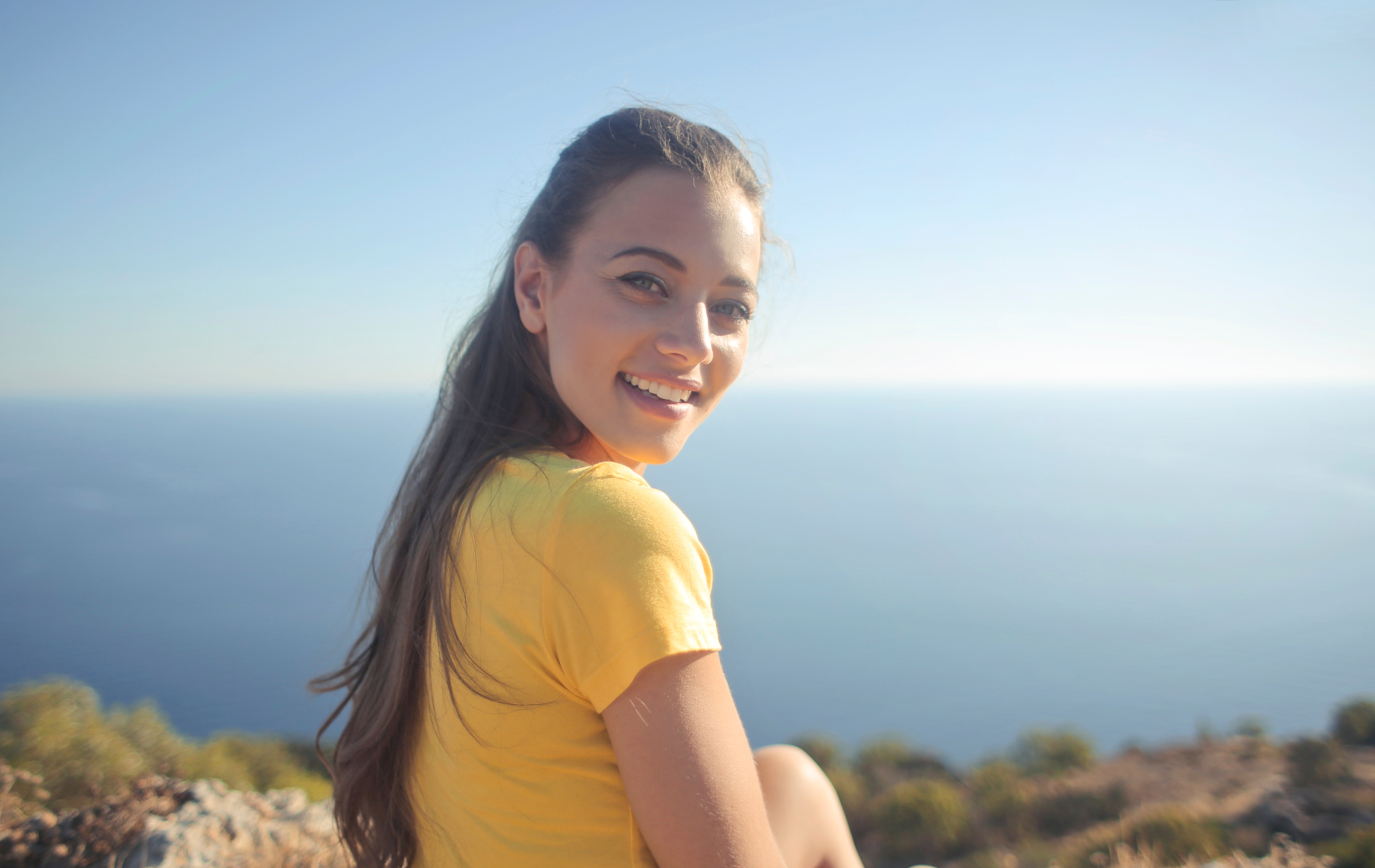 Woman wearing yellow shirt photo