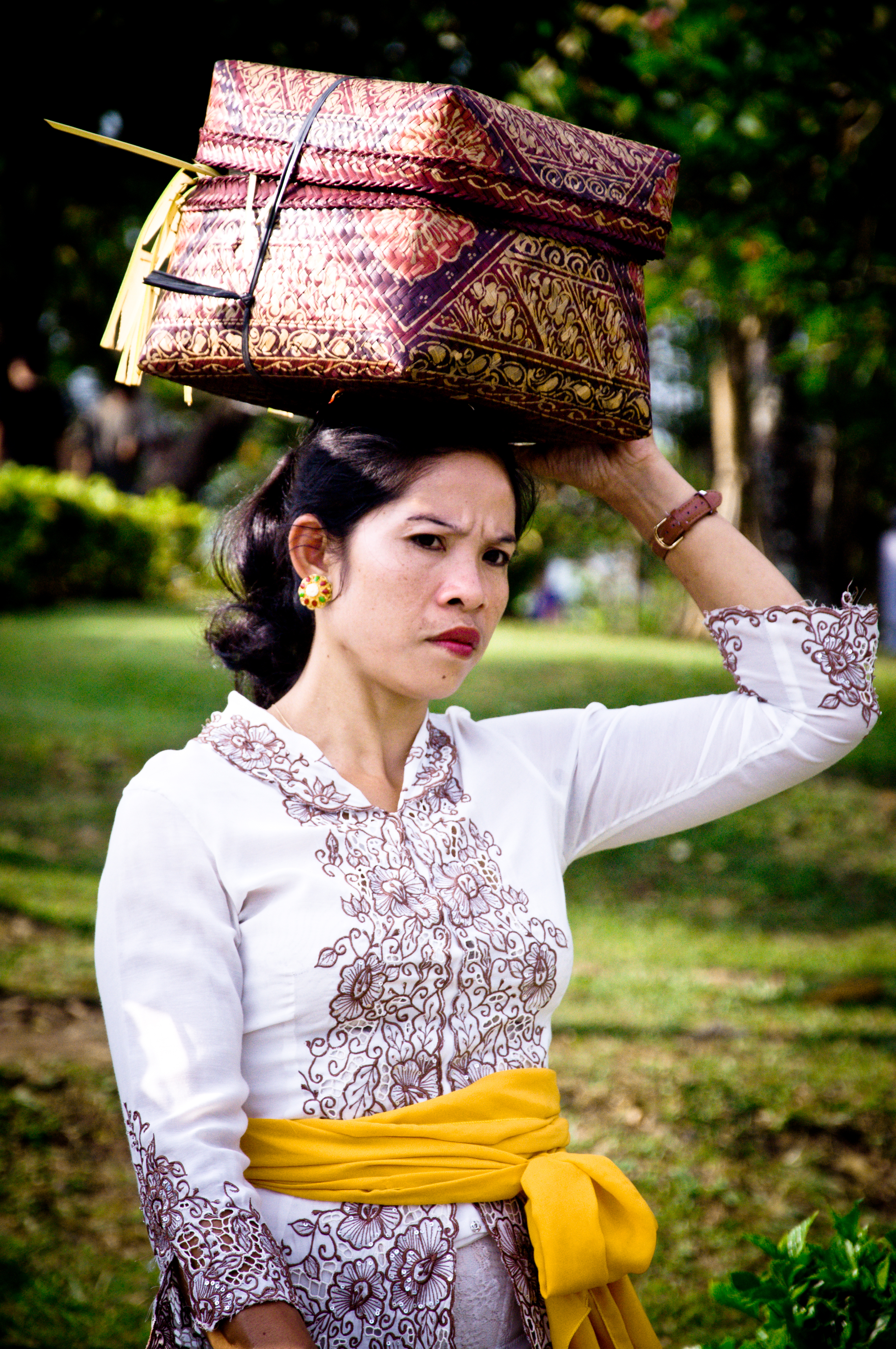 Woman with a basket on her head photo