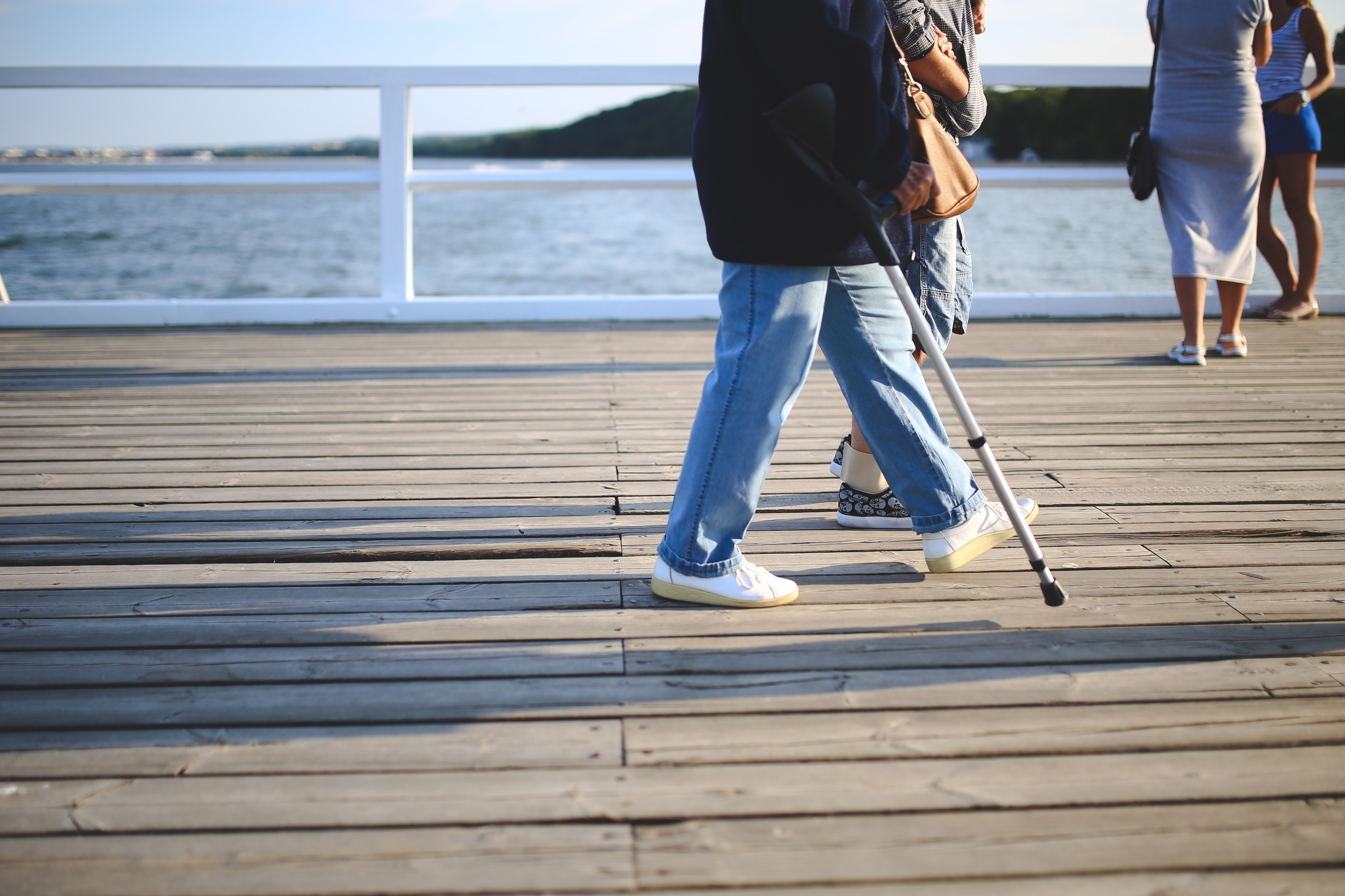 Woman with a crutch photo