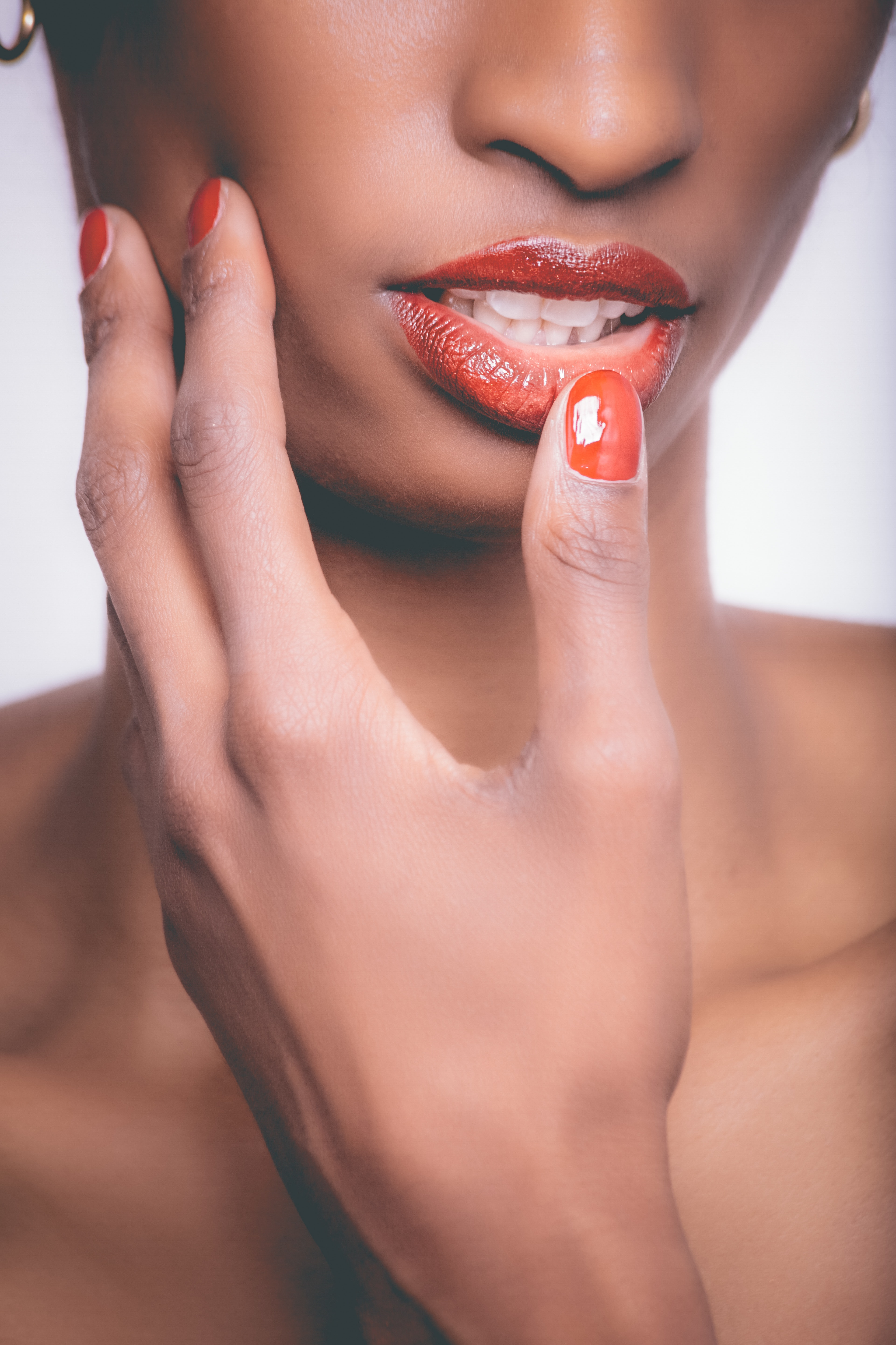 Woman with red lipstick and red manicure photo
