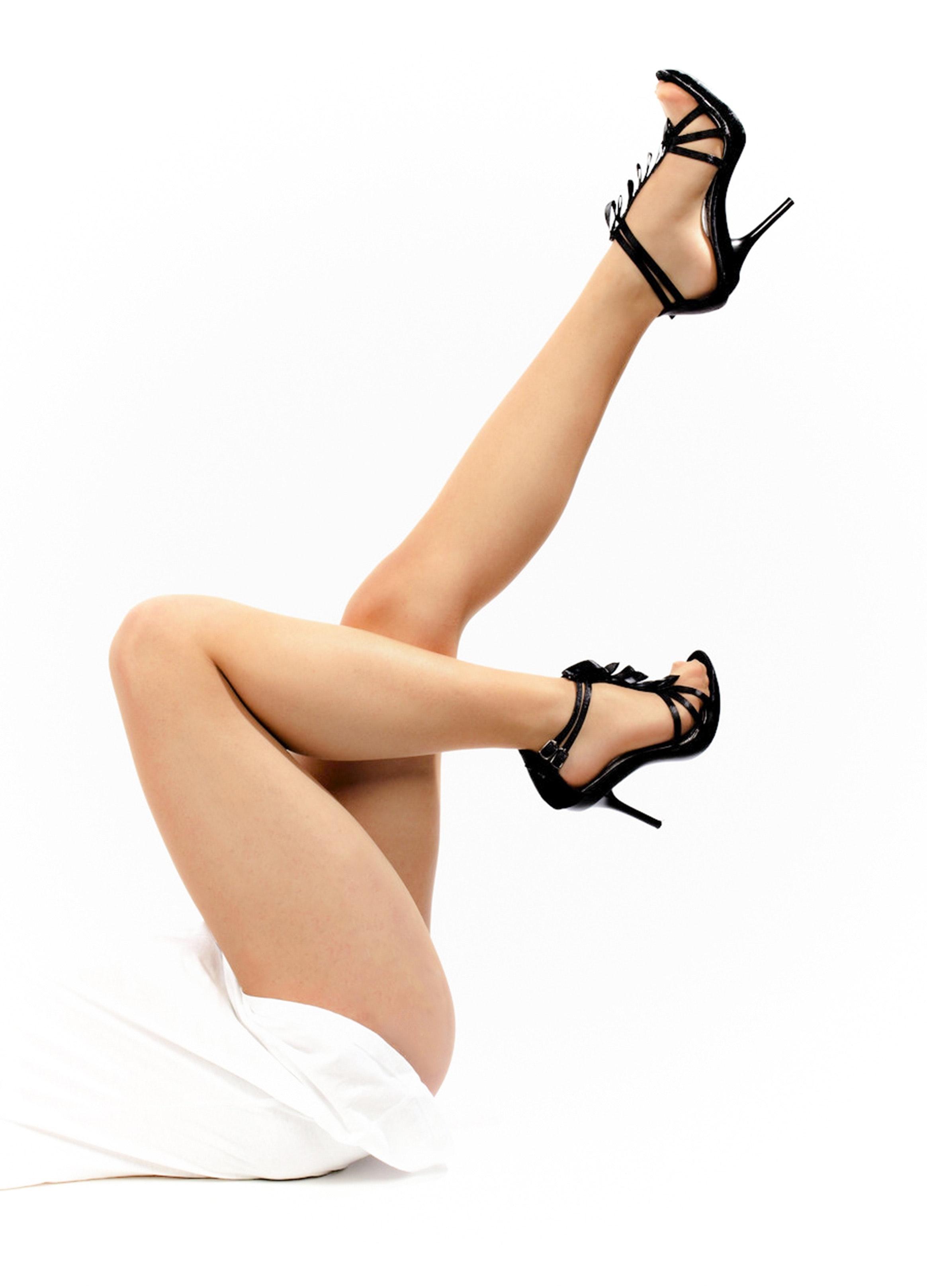 Woman's legs on white background photo