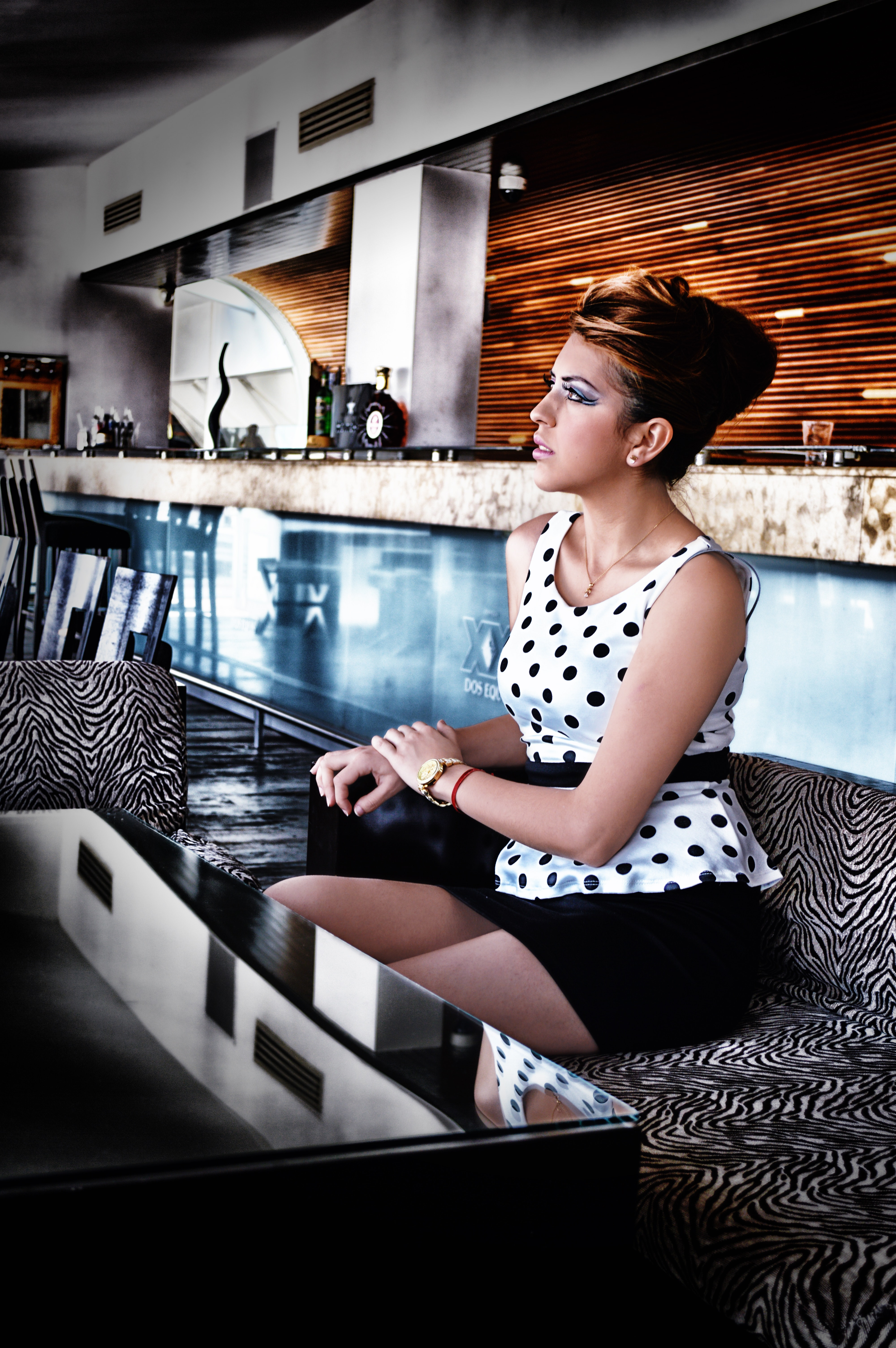 Women in white and black dress sitting on couch photo